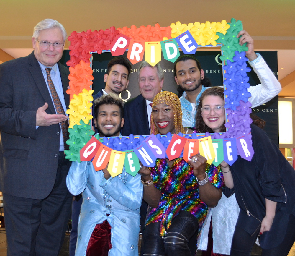 "Former NY State Senator Thomas ""Tom"" Duane (standing, far left); top row: LGBTQ activist and social worker Brian Romero, Council Member Daniel Dromm, dance artist Rajeev Singh; bottom row: dance artist Sean Kulsum, vocalist Anthony Wayne, and Generation Q Director Lindsey Duel celebrate LGBT Pride at Dromm's annual event at Queens Center Mall. Photo courtesy of the Office of Daniel Dromm."