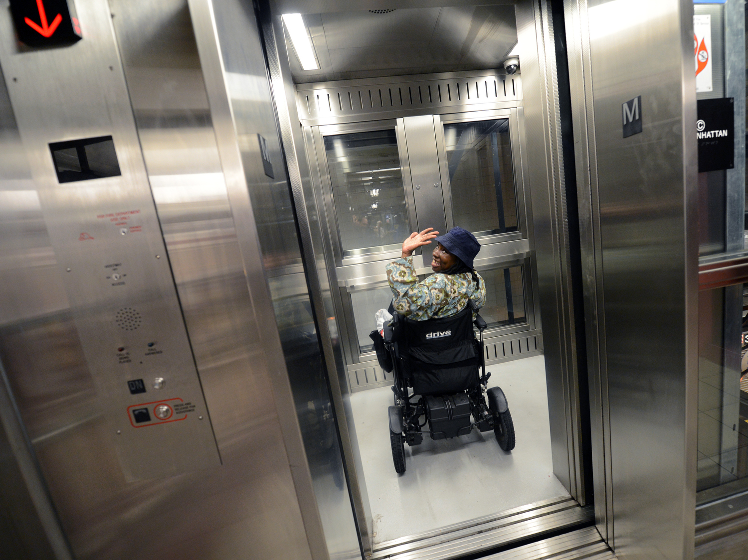 An individual in a wheelchair accesses the Utica Avenue subway station using an elevator. Such accessible subway stations are few and far between, according to a lawsuit filed against the MTA. Photo by Marc A. Herman/MTA New York City Transit via Flickr