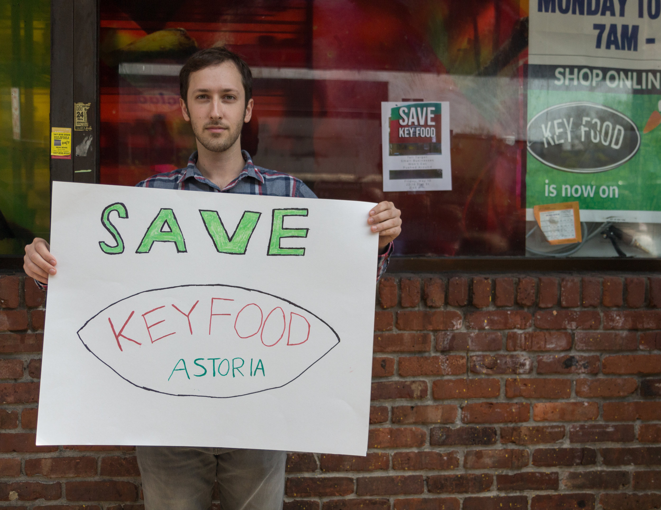 Astoria residents like Jesse Cerrotti say they want to save the 31st Street Key Food, which is threatened by a planned Target. The store owner said he is willing to share the space with Target.  Eagle  photo by Jonathan Sperling.