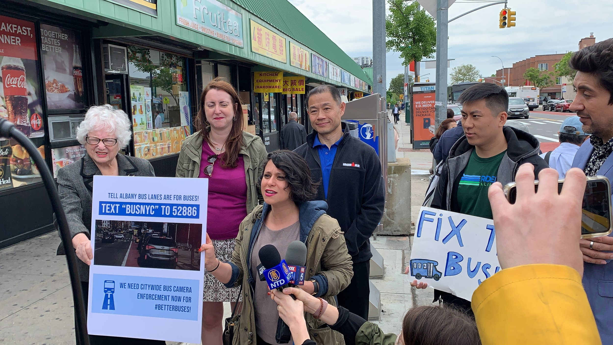 State Sen. Toby Ann Stavisky (left) and State Sen. John Liu (center) join transit advocates at a rally for Queens bus lane enforcement. Photo courtesy of Jorge Muniz/Riders Alliance.