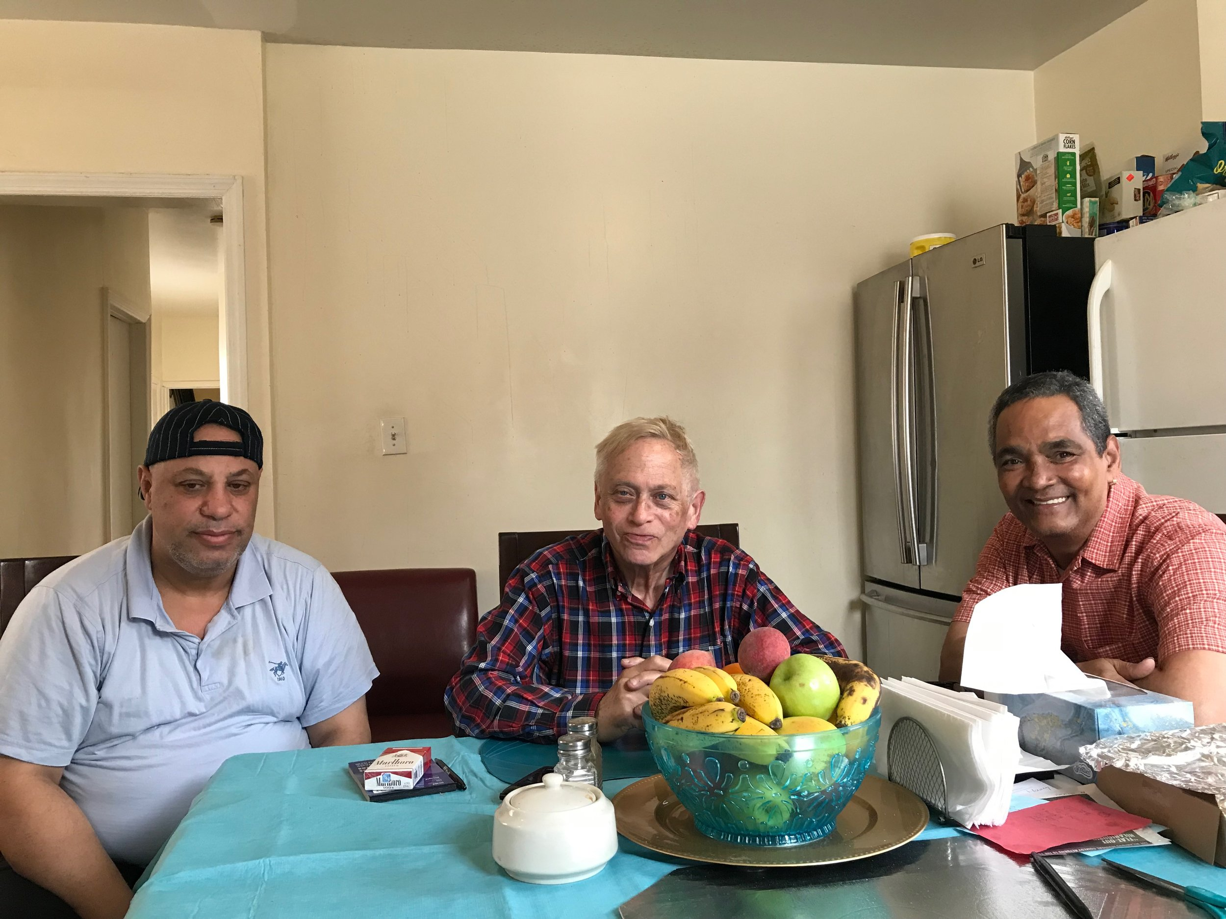Khamis Mohamed (left), Bill Lindauer (center) and Edwin Amadeo face an uncertain future at their Long Island City apartment building. Eagle photo by David Brand.