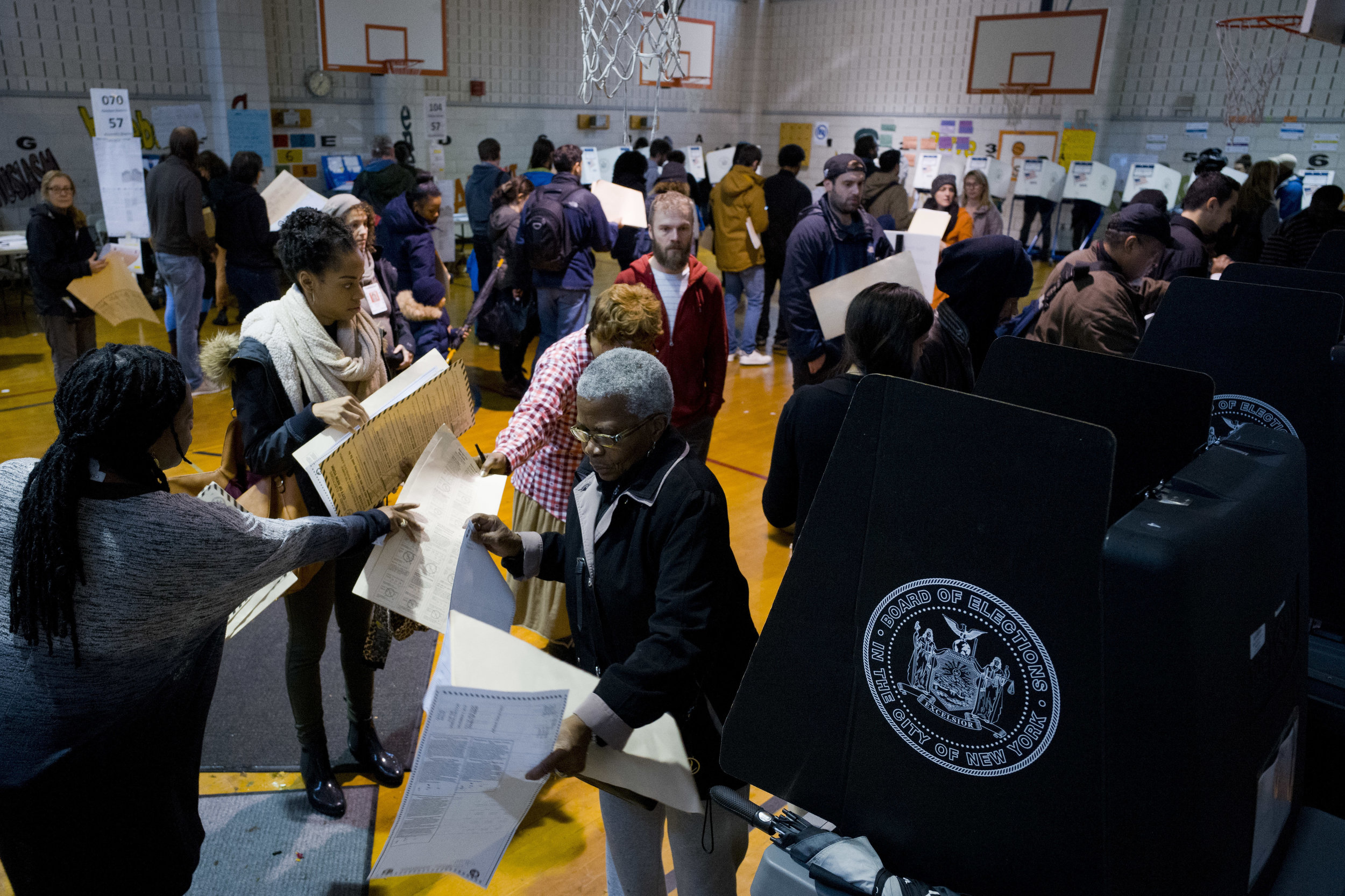 NEW YORKERS WAIT TO CAST THEIR BALLOTS DURING THE 2018 MIDTERM ELECTIONS. AP Photo/Mark Lennihan