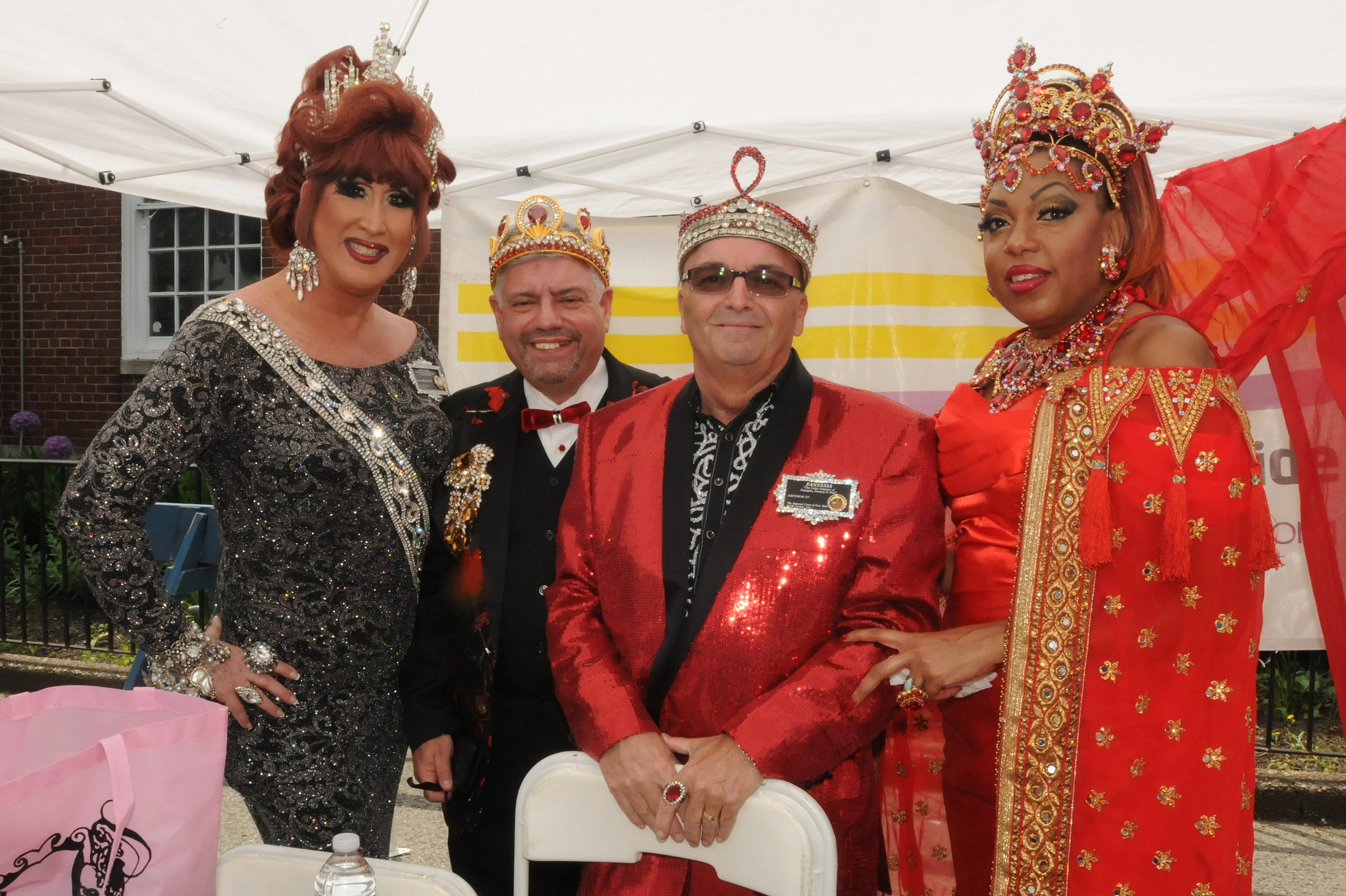 "Pride ""Royalty"" observe the parade from the reviewing stand. From left to right, Empress Annetique  Emperor Tony Monteleone, Emperor Fantasia and Empress Sugar B. Real."