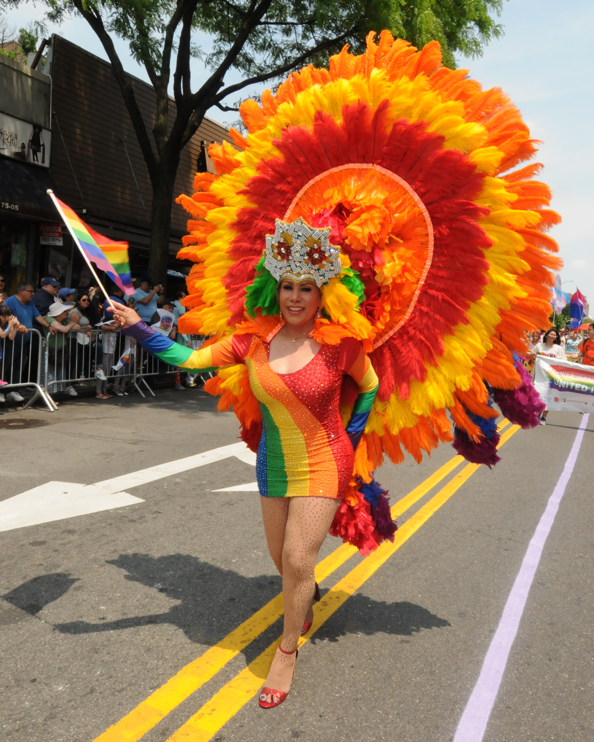 A paradegoer brightens the route in Jackson Heights.