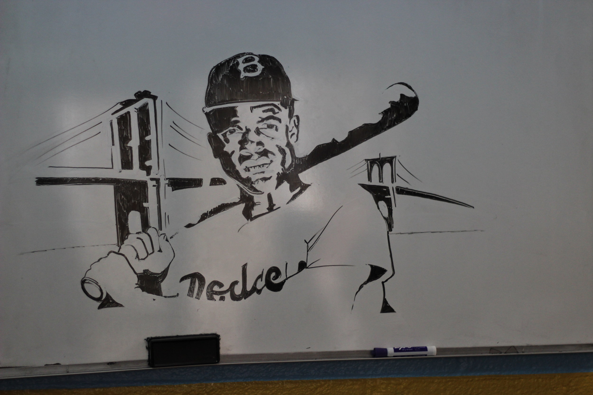 An illustration of Robinson on a whiteboard at Astoria's Our World Neighborhood Charter School.