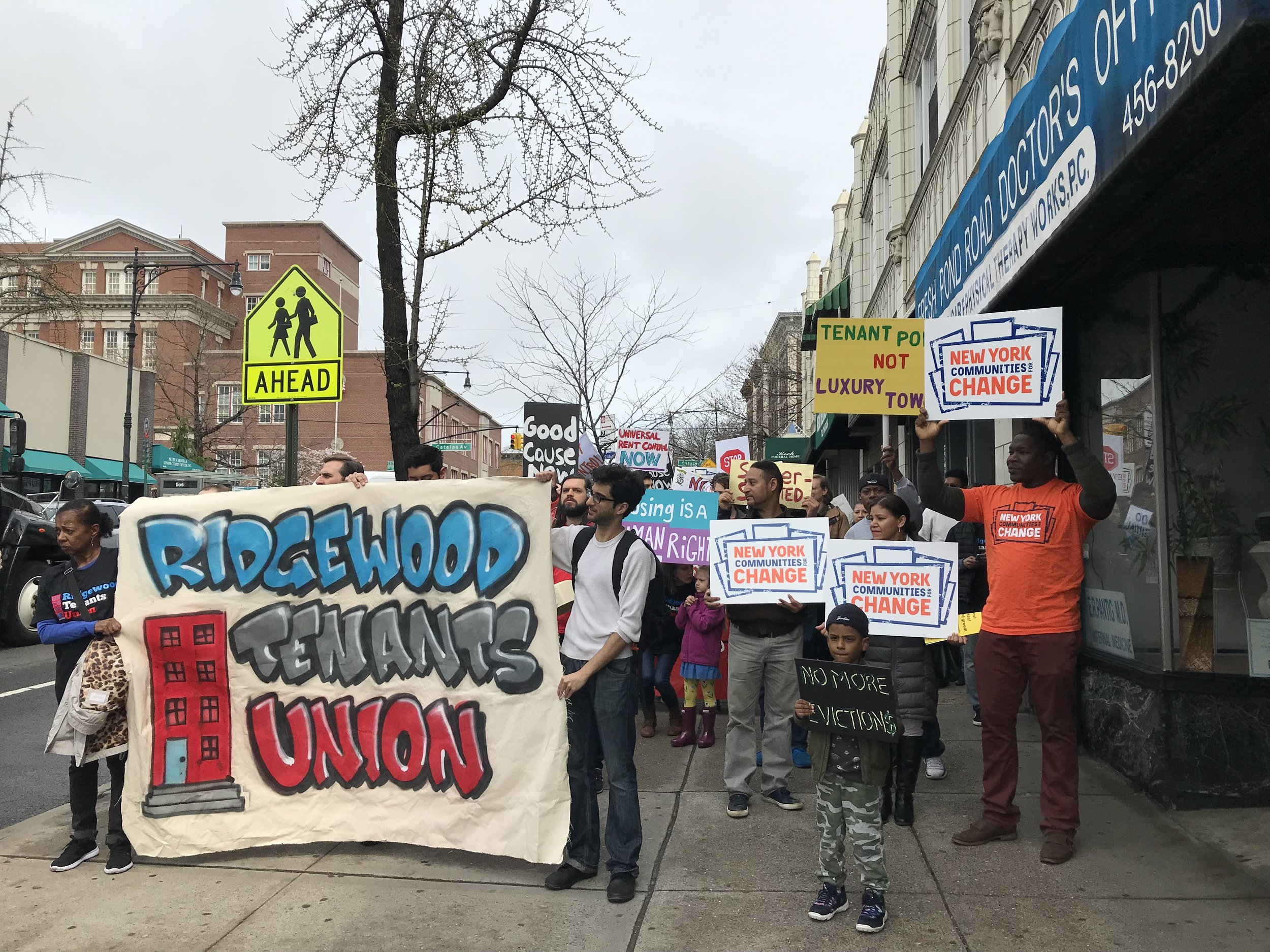 Ridgewood Tenants Union members demonstrate for tenant protections in April. Eagle photo by David Brand.