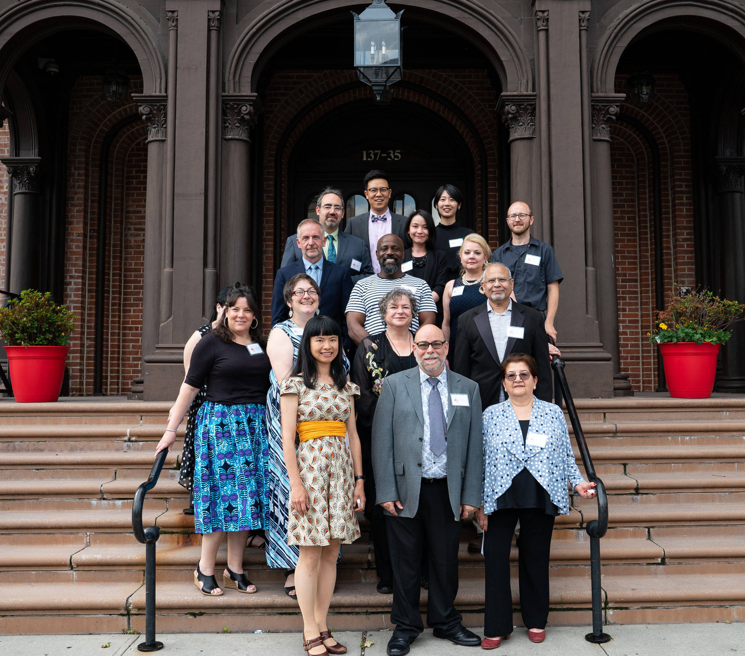 Flushing Town Hall held its 40th annual gala on June 6, 2019. Pictured are staff members on the steps of the landmark institution.