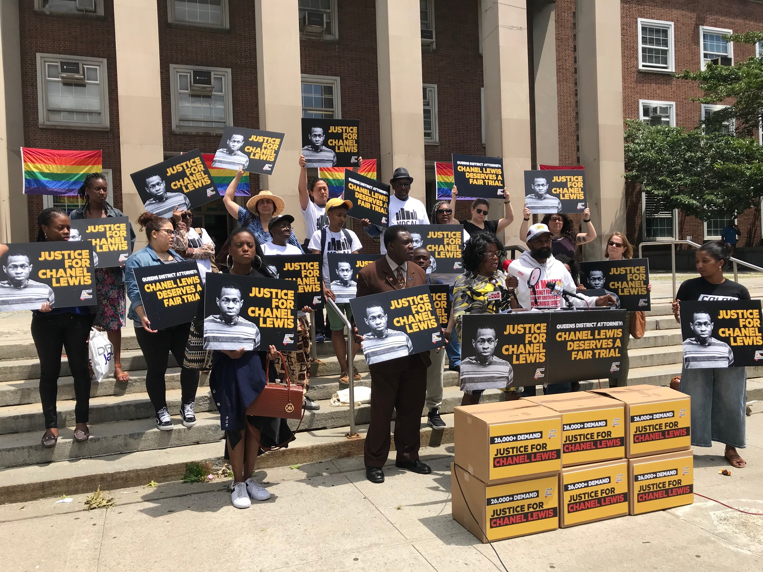 Advocates and the family of Chanel Lewis demonstrate outside Queens Borough Hall Tuesday.  Eagle  photo by David Brand.