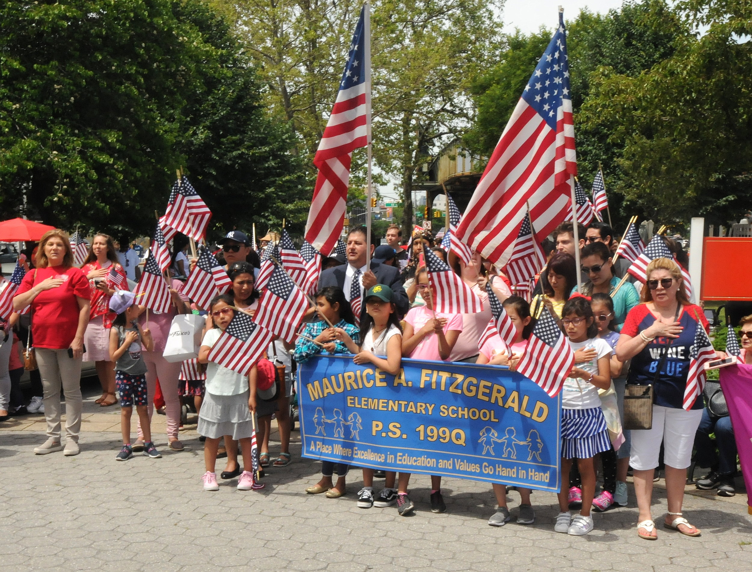 Students from PS 199 participate in the procession.  Eagle  photos by Walter Karling.