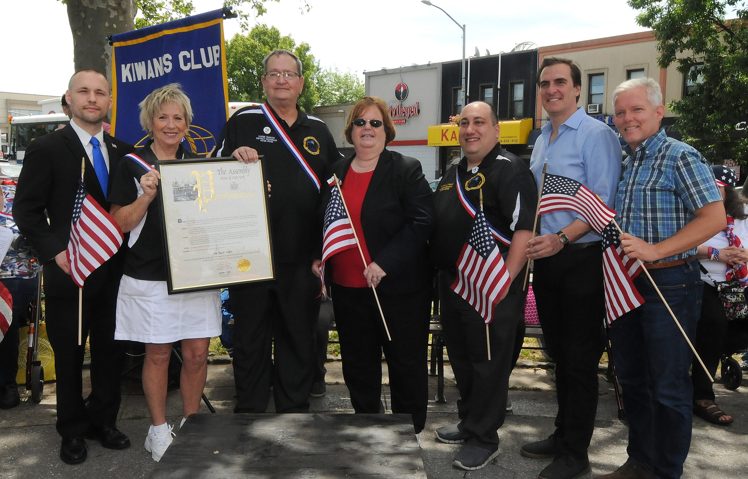 From left: Assemblymember Brian Barnwell; Bonnie Baker; award recipient and parade Grand Marshal Hank Beker, the Governor of the Kiwanis New York State District; Assemblymember Cathy Nolan; Anthony Pappas,the Lieutenant Governor of the Queens West Division; State Sen. Michael Gianaris and Councilmember Jimmy Van Bramer.