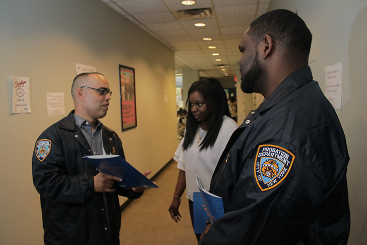 Probation officers at work. Photo courtesy of the Department of Probation.