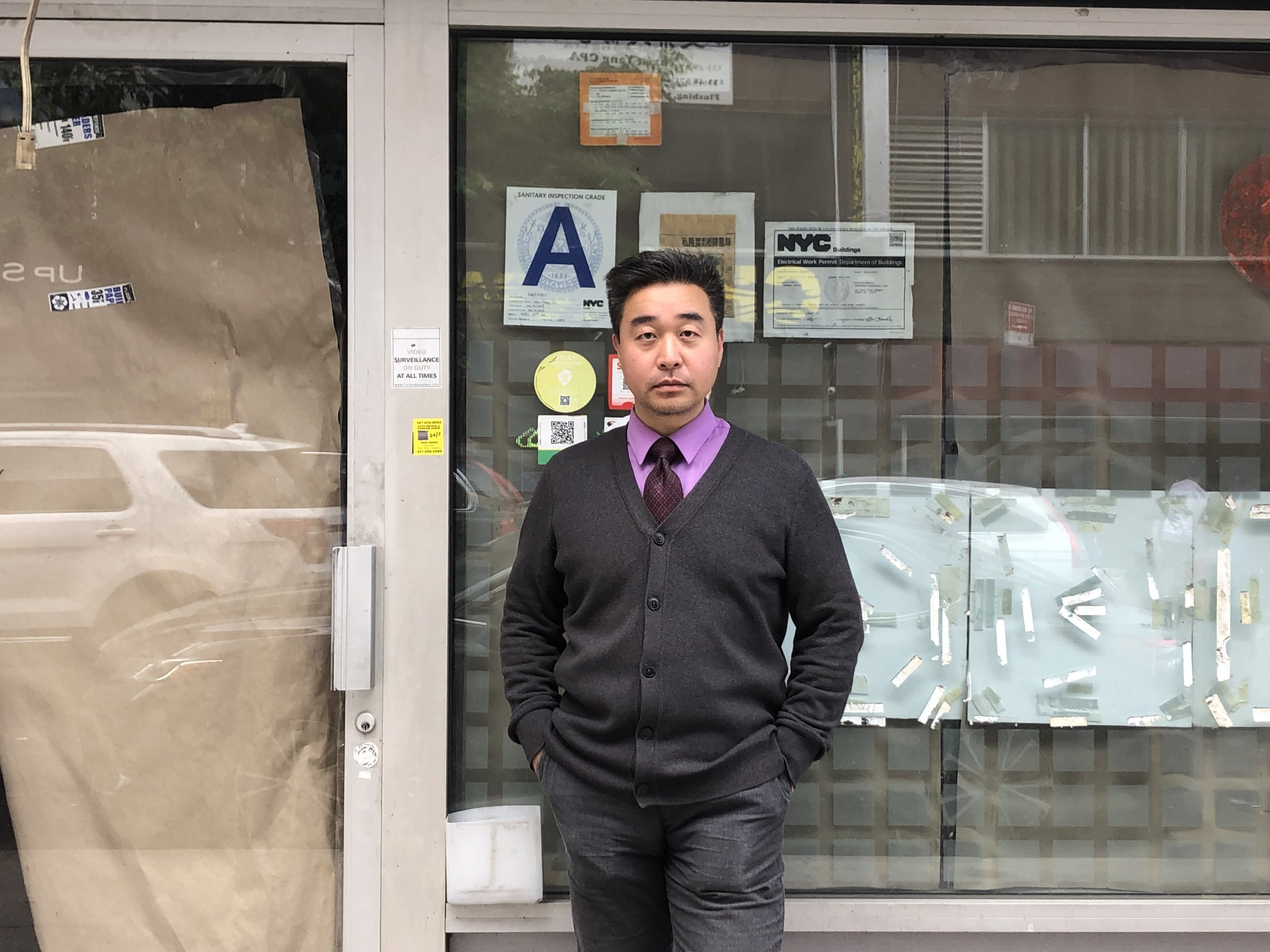 John Choe, the executive director of the Greater Flushing Chamber of Commerce, catalogs business closures and guided the Eagle on a tour of the shuttered shops and restaurants.  Eagle  photo by Naeisha Rose.