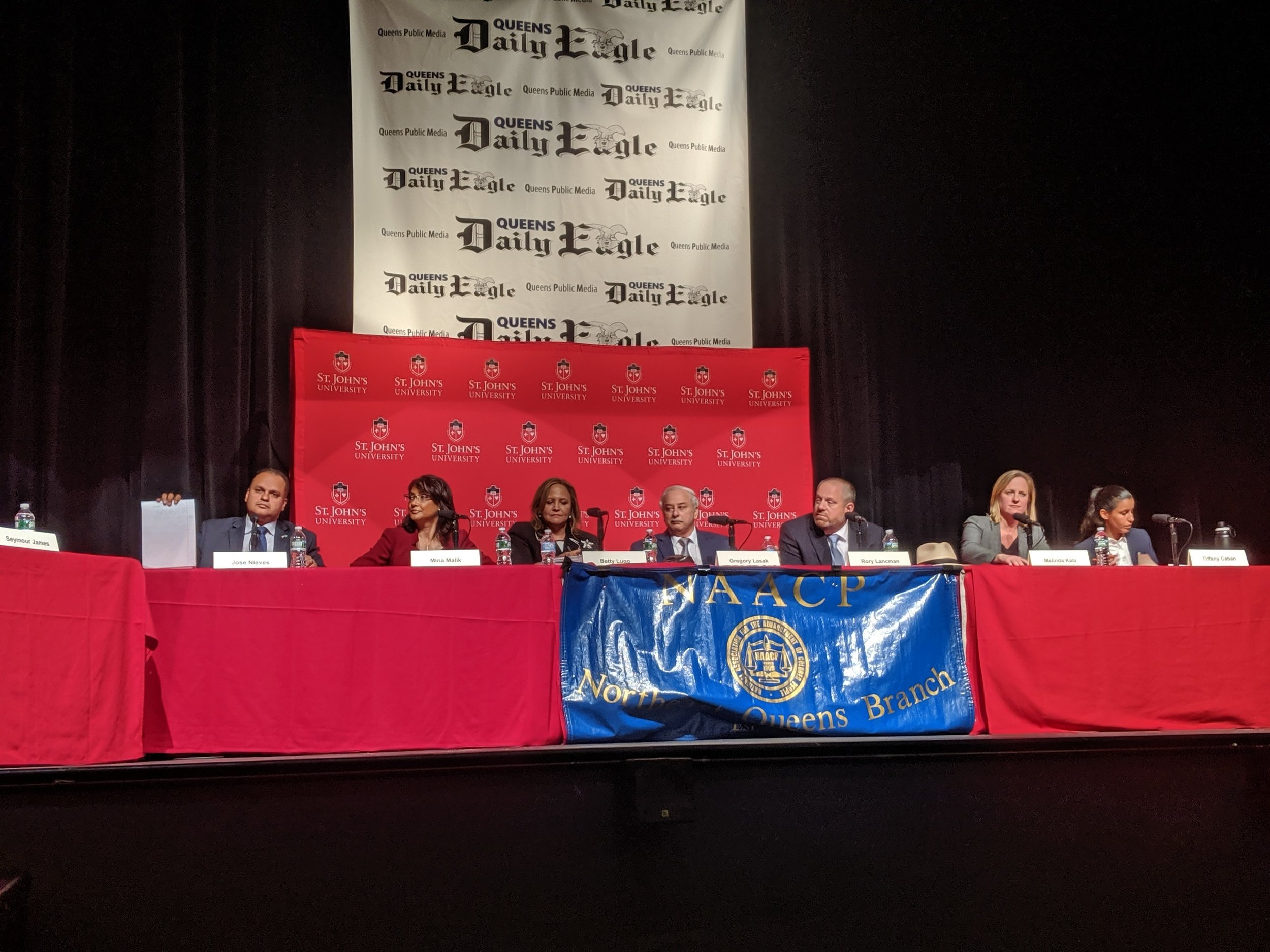 The seven candidates for Queens DA spoke at a forum hosted by the  Eagle  Thursday: public defender Tiffany Cabán, Borough President Melinda Katz, Councilmember Rory Lancman, former Judge Gregory Lasak, attorney Betty Lugo, former Civilian Complaint Review Board Director Mina Malik and former state Attorney General's Office prosecutor Jose Nieves.  Eagle  photo by Phineas Rueckert.