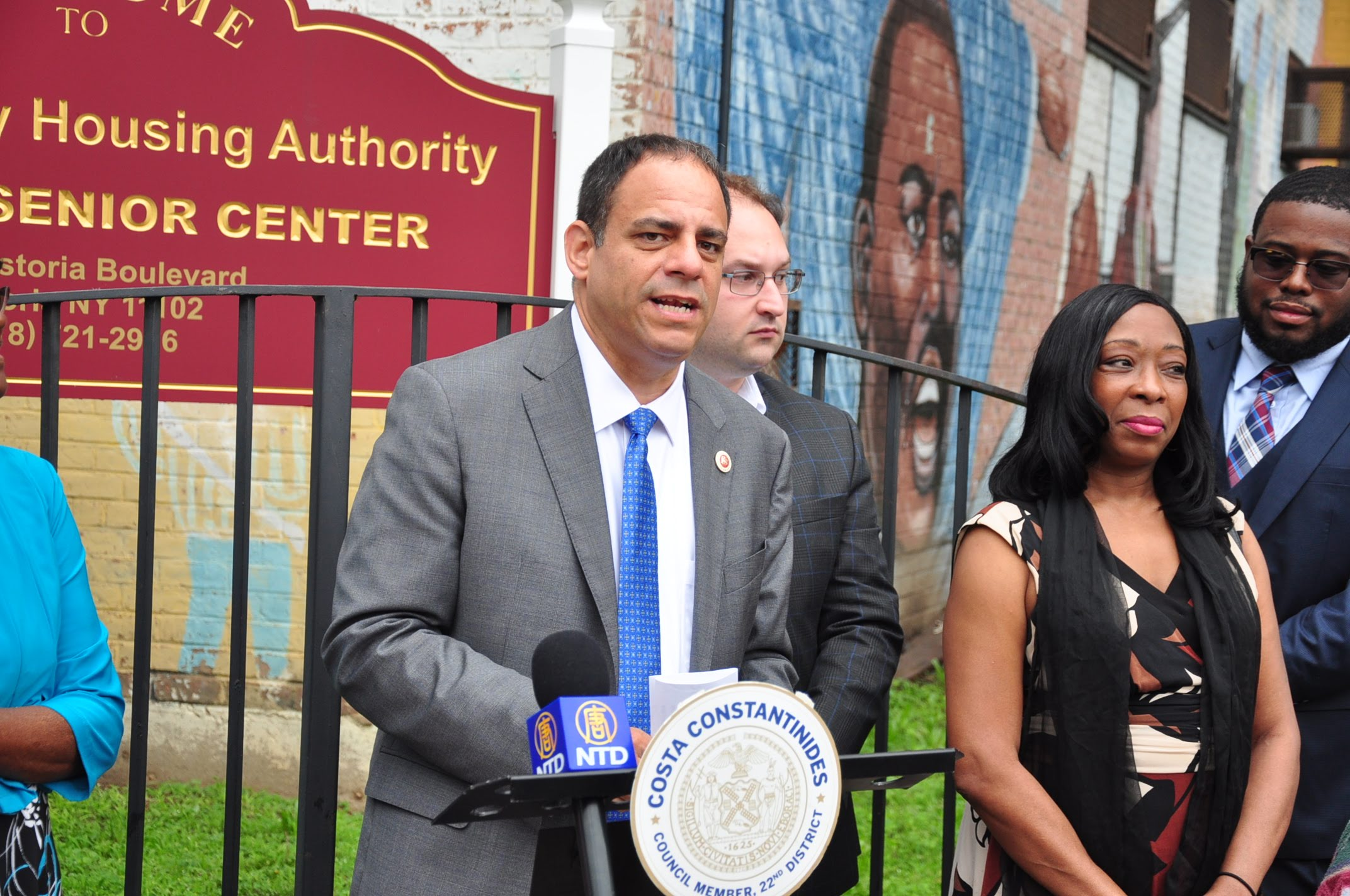 Councilmember Costa Constantinides speaks in front of the Astoria Houses on Thursday. He helped advocate for the buildings' senior center to remain open.