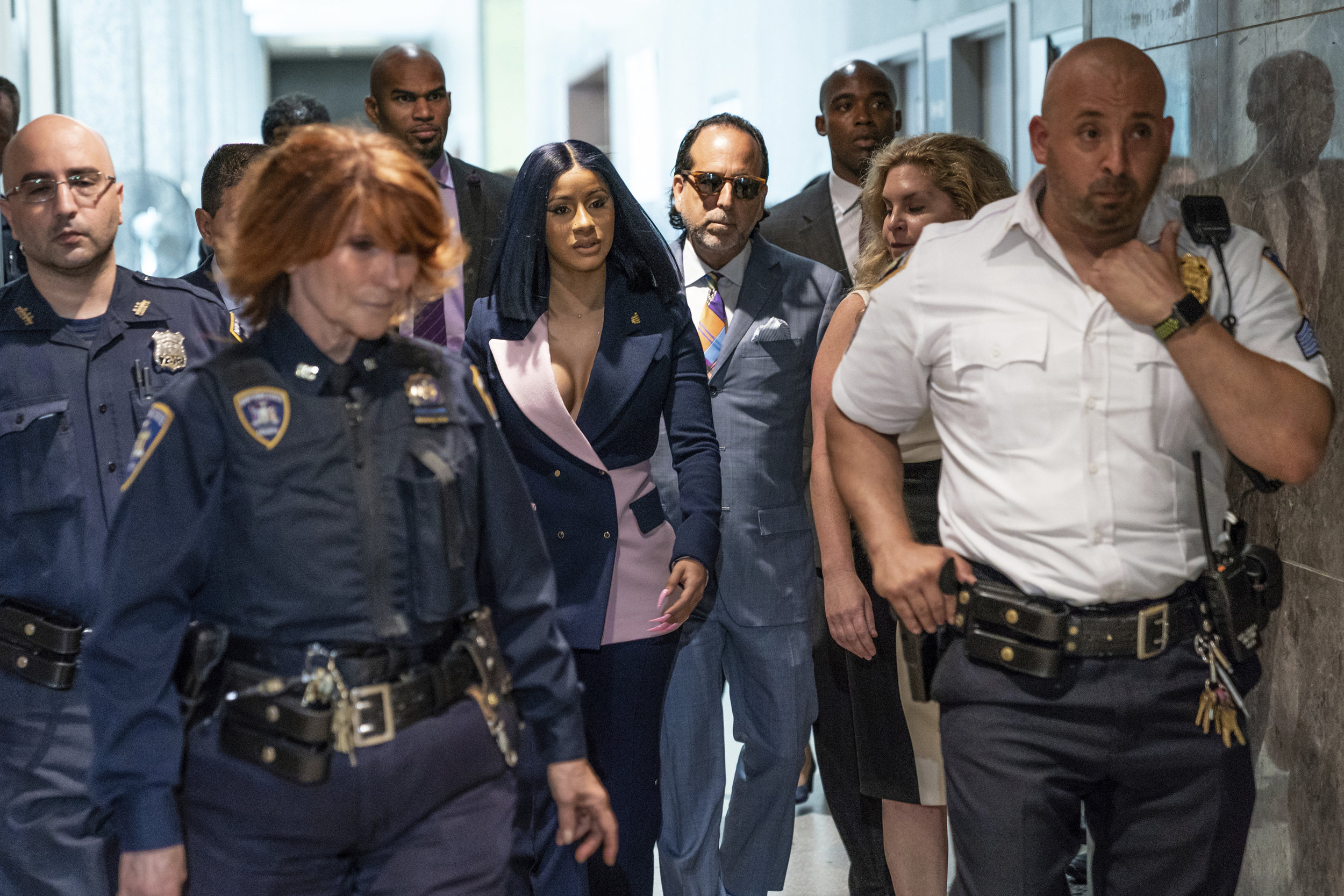 Grammy-winning rapper Cardi B arrives for a hearing at Queens County Criminal Court, Tuesday. She was arraigned on new felony charges in connection with a fight last year at a Flushing strip club. Photo by Uli Seit/ The New York Times  via AP, Pool.