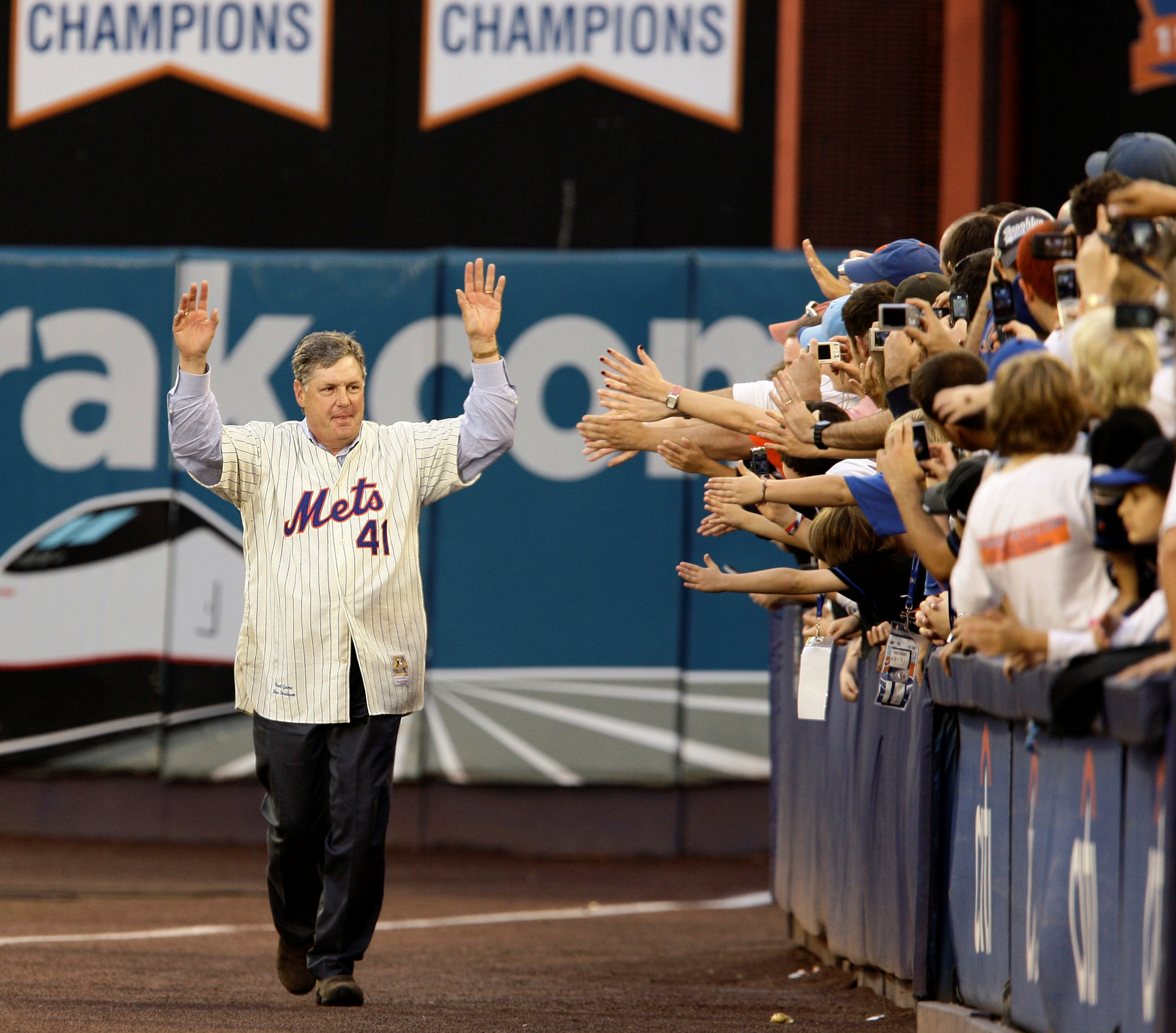 Hall of Fame pitcher Tom Seaver acknowledges the fans after the final game at shea stadium in 2008. AP Photo/Kathy Willens, File.