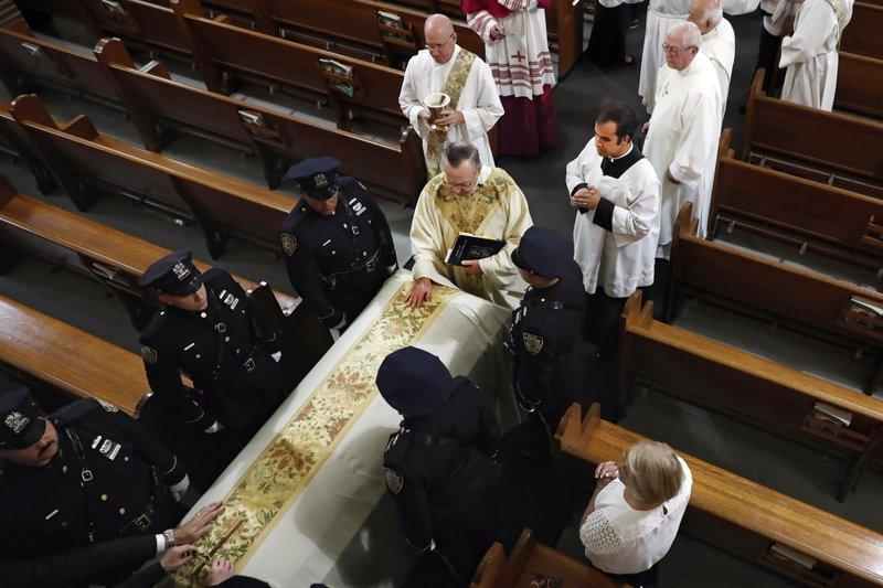 Rev. John P. Harrington blesses the casket. AP Photo/Richard Drew, Pool. AP Photo/Richard Drew, pool.