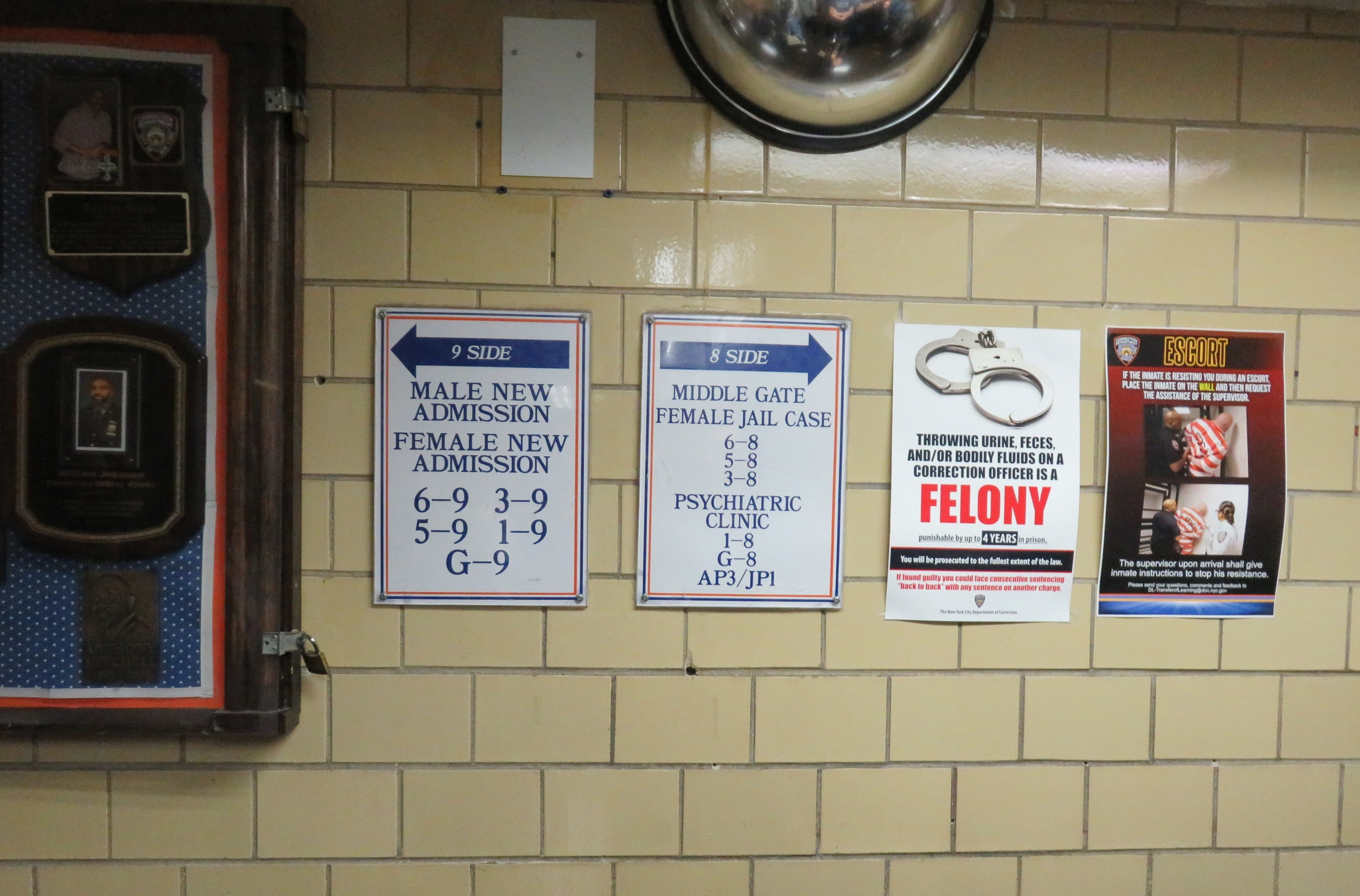 Signs warn detainees not to assault correction staff.