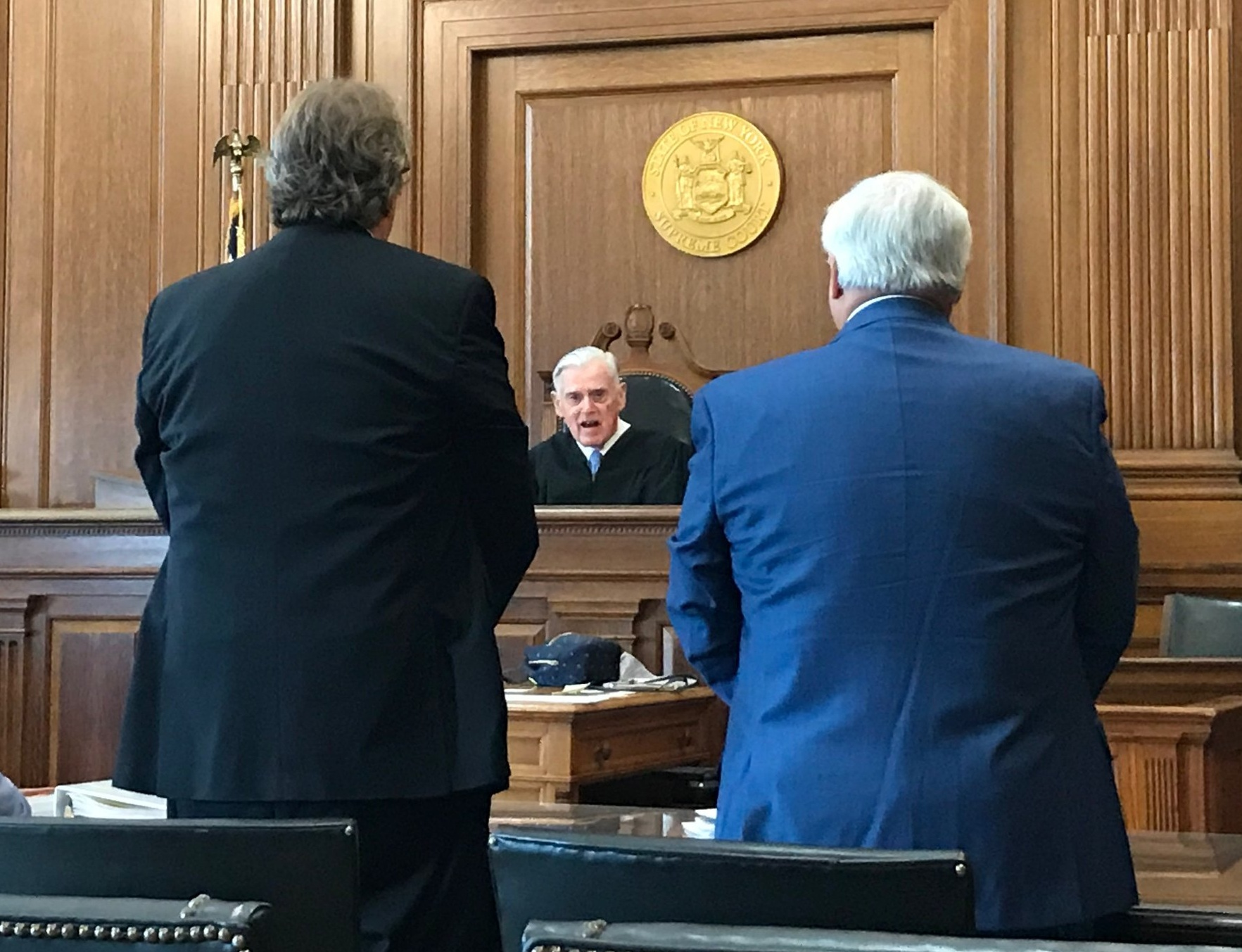 Justice John Ingram addresses Melinda Katz's campaign lawyers Frank Bolx (left) and Michael Reich (right).  Eagle  photo by David Brand