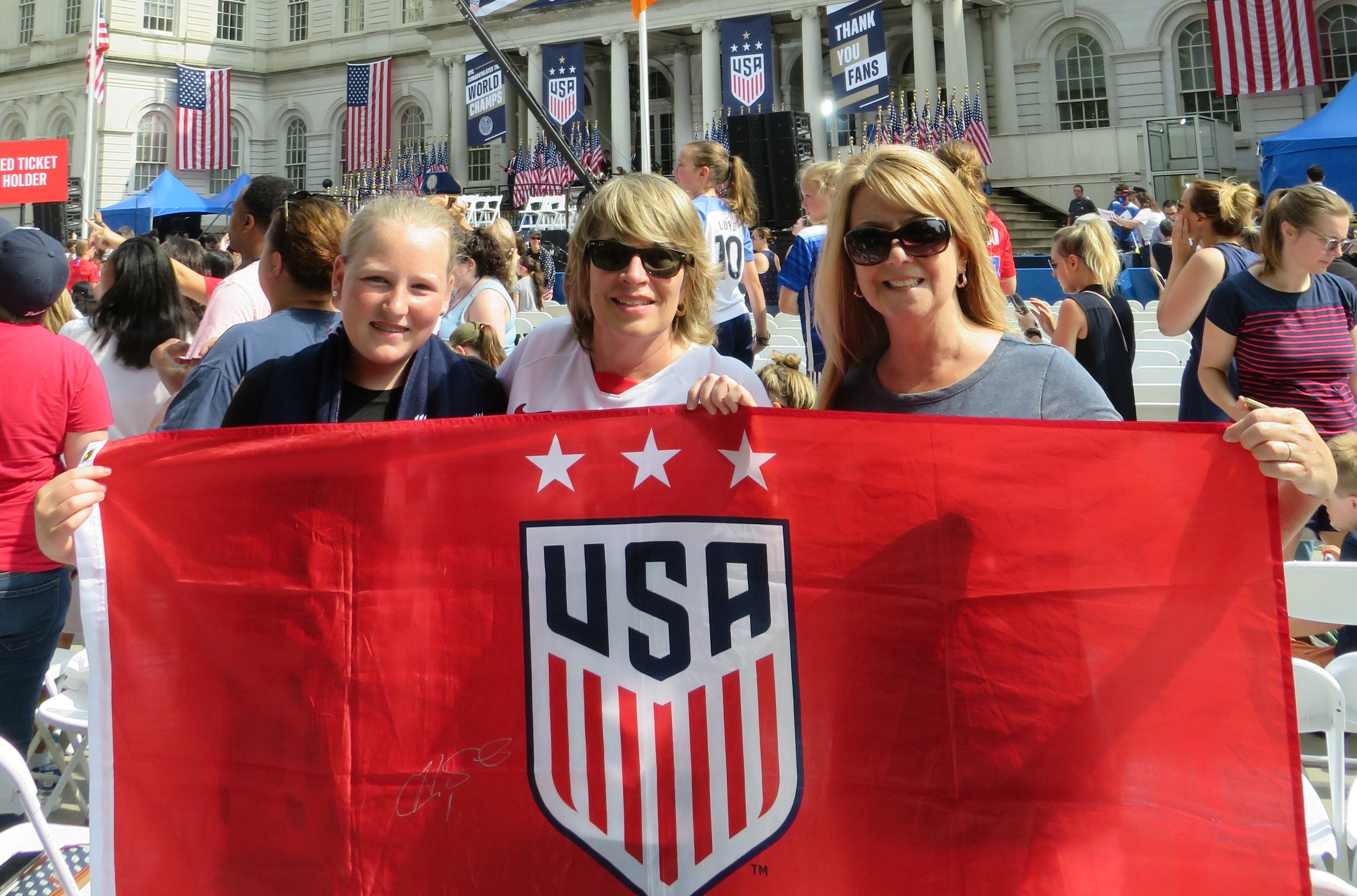 Kate M, Anna Monteiro and Nancy Buonomassa are die-hard US Soccer fans. Monteiro attended three tournament games in France. Photo by David Brand