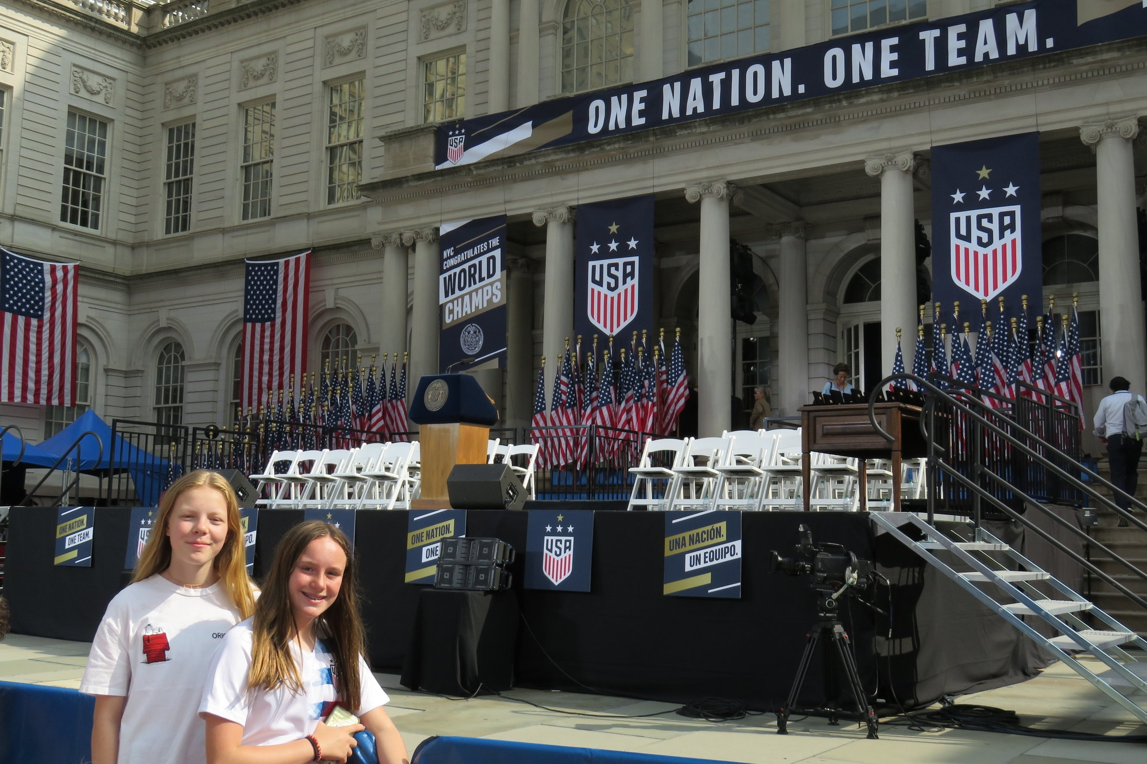Shannon Gallagher and Katie Porazio, both 12, await the US Womens National Team.