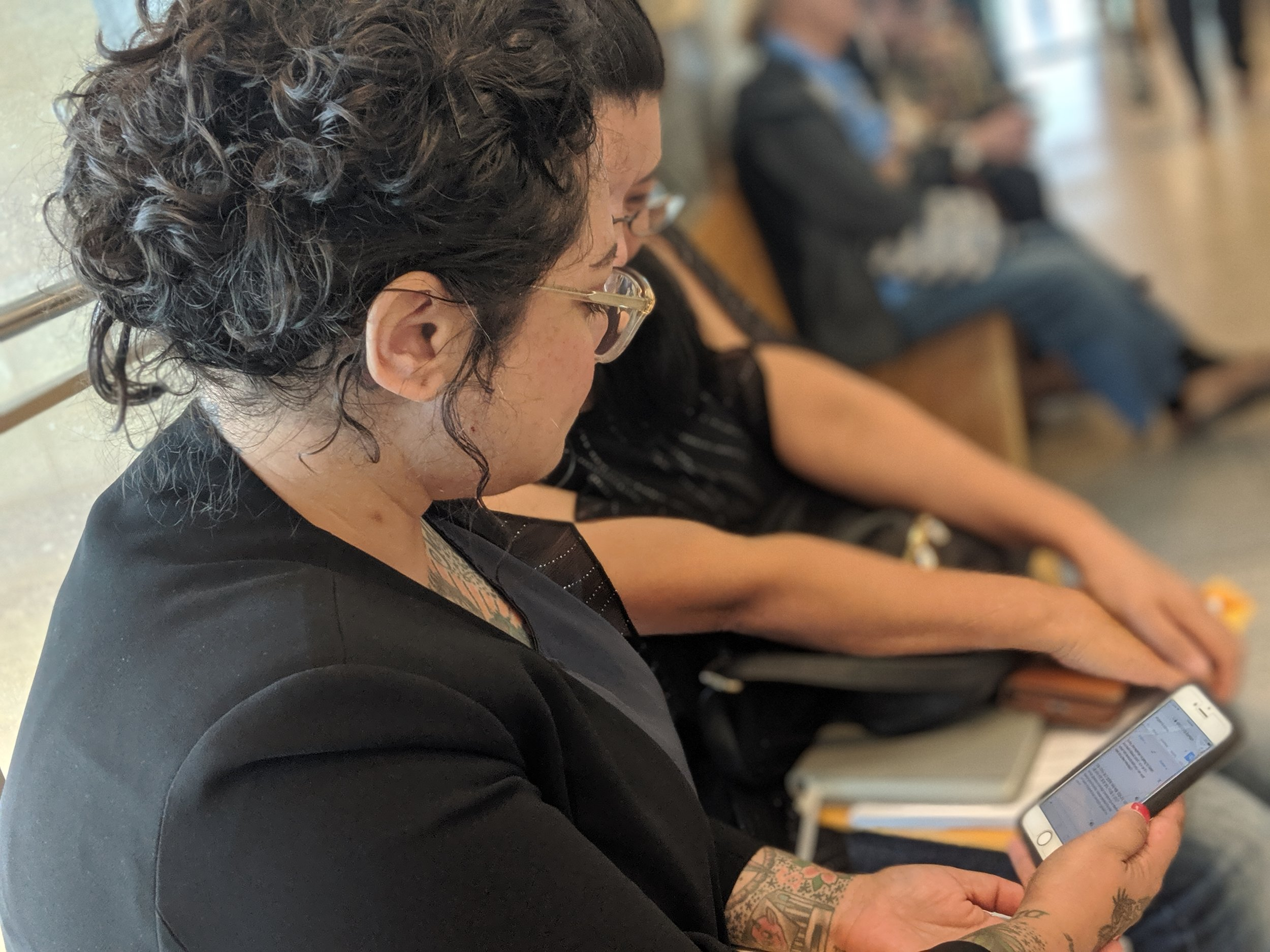 Queens Legal Services attorney Catherine Barreda uses an online translator tool to interpret court proceedings for a client.  Eagle  photo by Phineas Rueckert