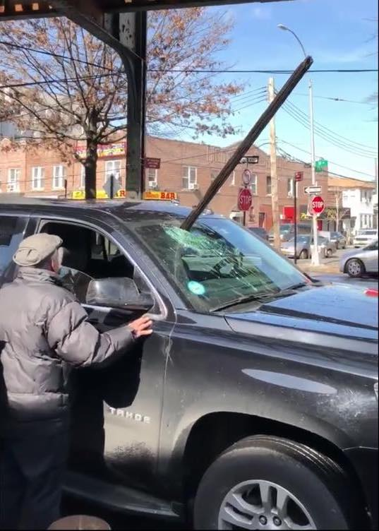 A spike fell from the No. 7 train and punctured a car windshield along Roosevelt Avenue in February. Photo courtesy of Councilmember Jimmy Van Bramer's office.