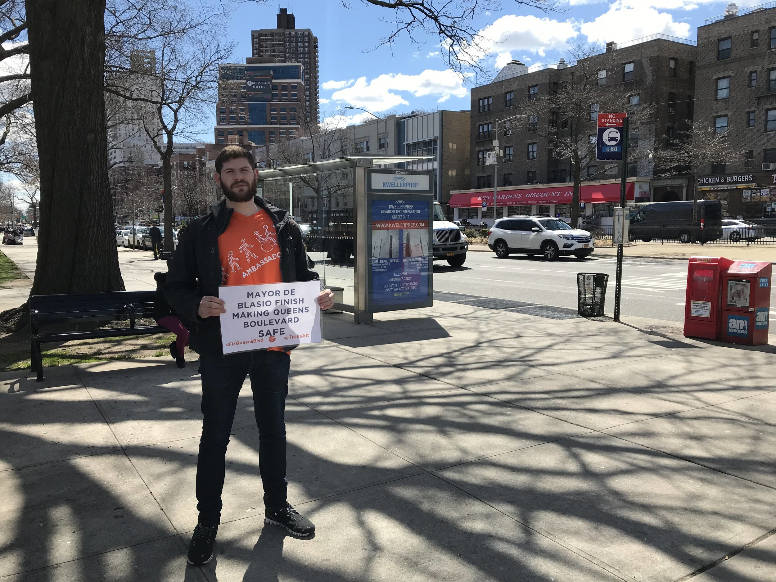Transportation Alternatives' Clark Vaccaro advocates for the city to complete bike lanes on Queens Boulevard in April.  Eagle  file photo by David Brand.