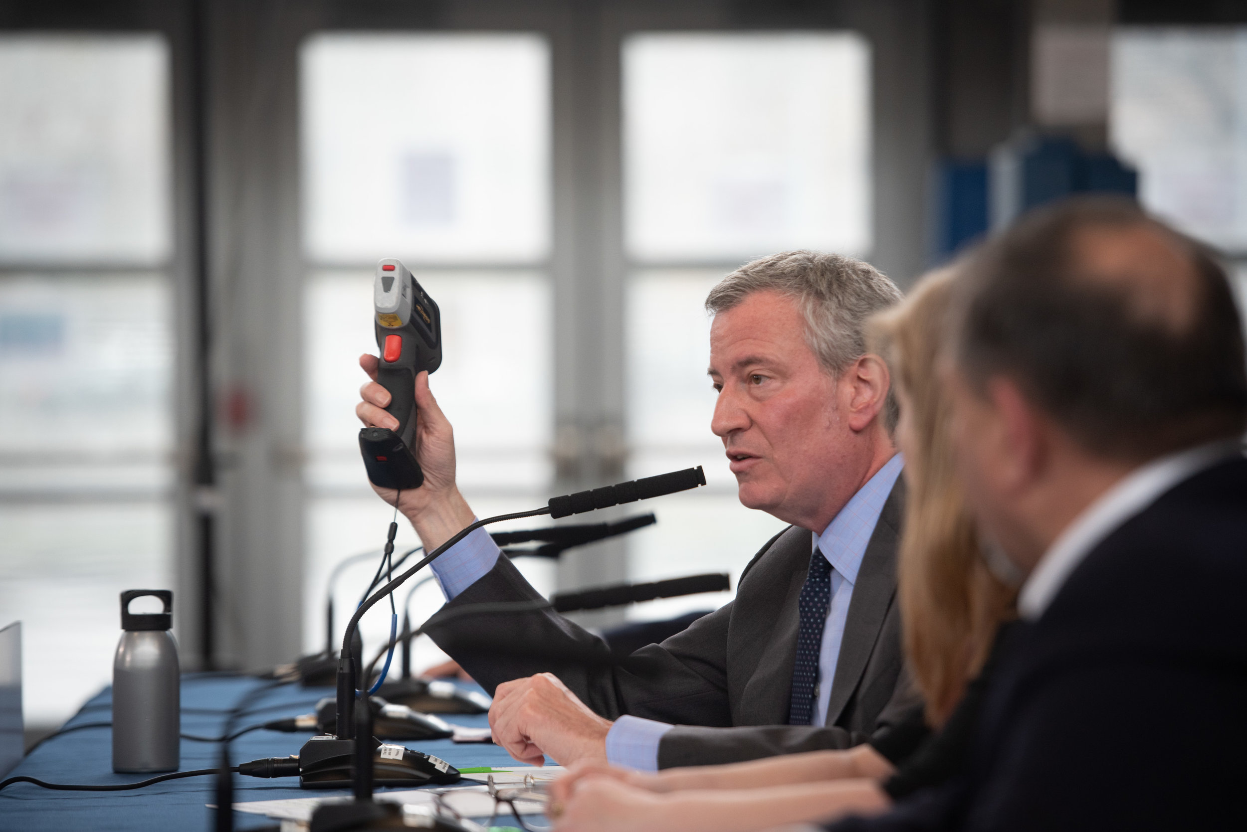 Mayor Bill de Blasio holds a portable x-ray fluorescence analyzer used to test for lead-based paint as he announces a plan to test at 135,000 nycha apartments in April. Photo by Michael Appleton/Mayoral photography