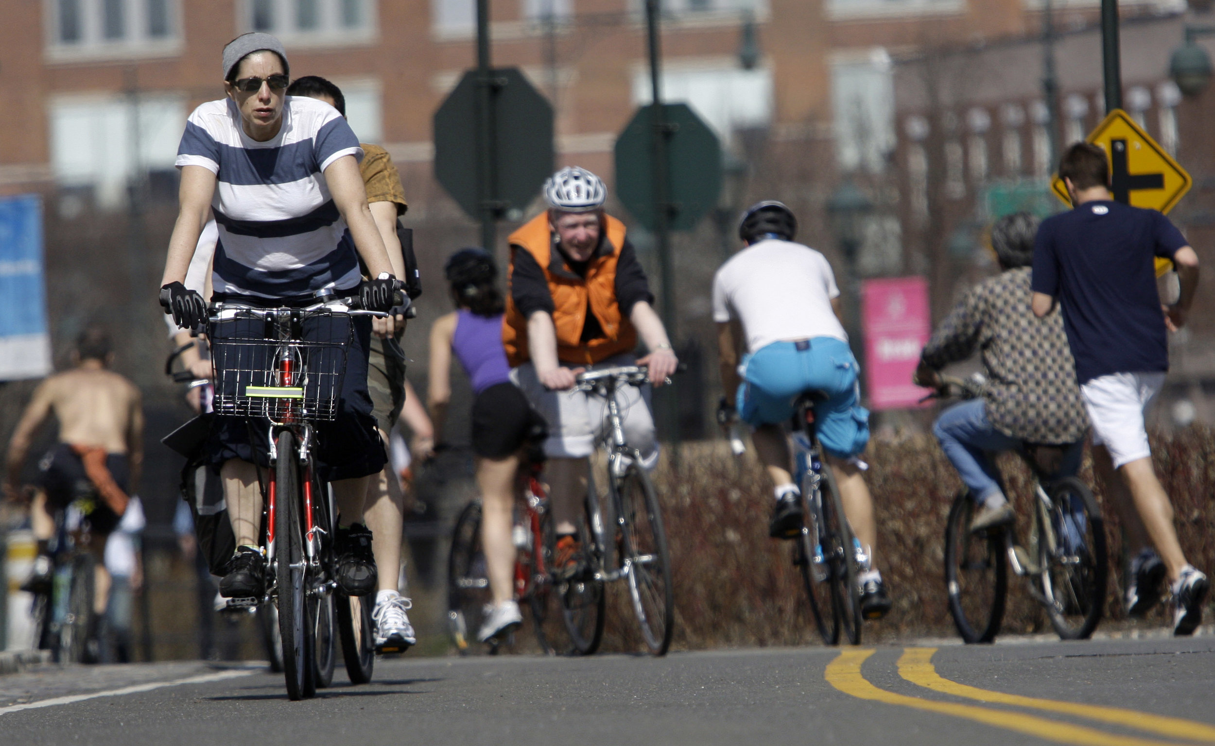 A bill passed by the City Council Tuesday would enables cyclists to follow pedestrian signals at crosswalks, rather than vehicular traffic signals. AP Photo/Frank Franklin II.