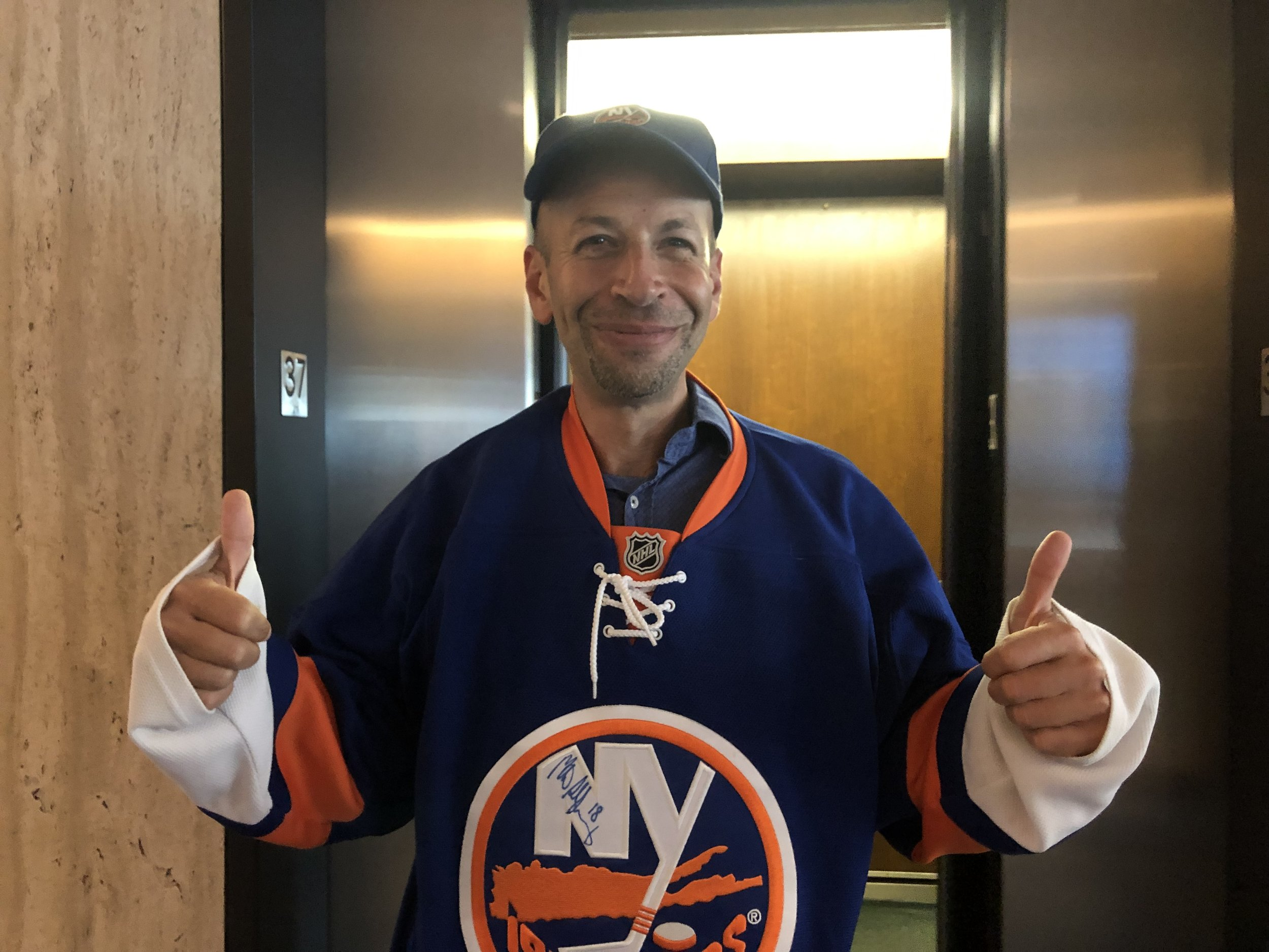 Islanders fan Sam Schneider said he approves of a project to build a new arena in Elmont, Long Island, just over the Queens border.  Eagle  photo by Naeisha Rose.