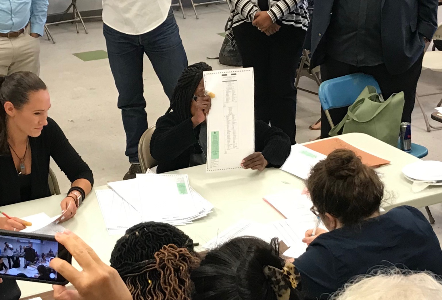 A BOE official holds up the very last ballot during the recount in the Democratic primary for Queens DA.  Eagle  photo by David Brand