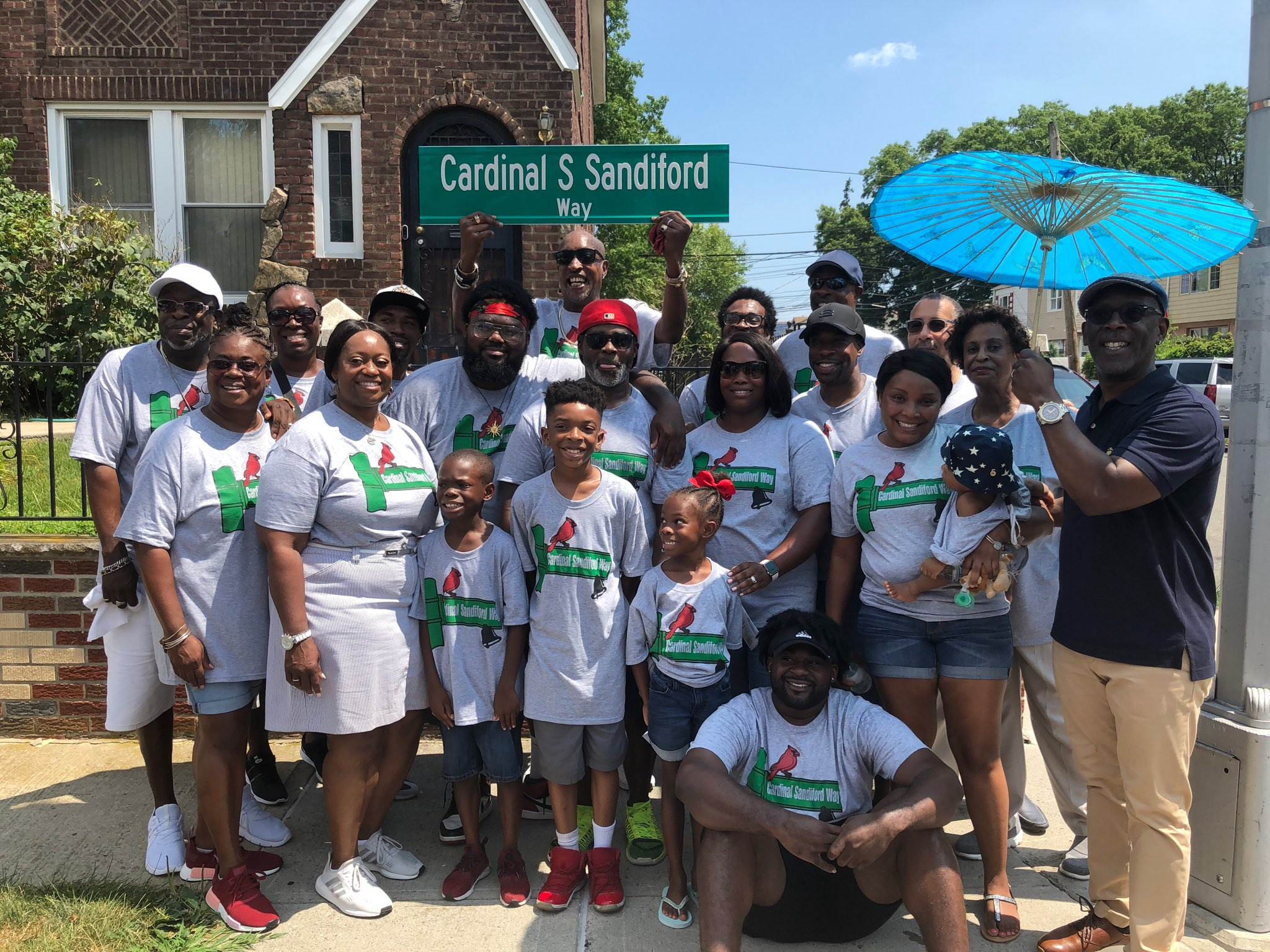 Community leaders, including Councilmembers I. Daneek Miller and Adrienne Adams, attended a street renaming ceremony for late-Community Board 12 member Cardinal Sandiford. Photo courtesy of Miller's office.