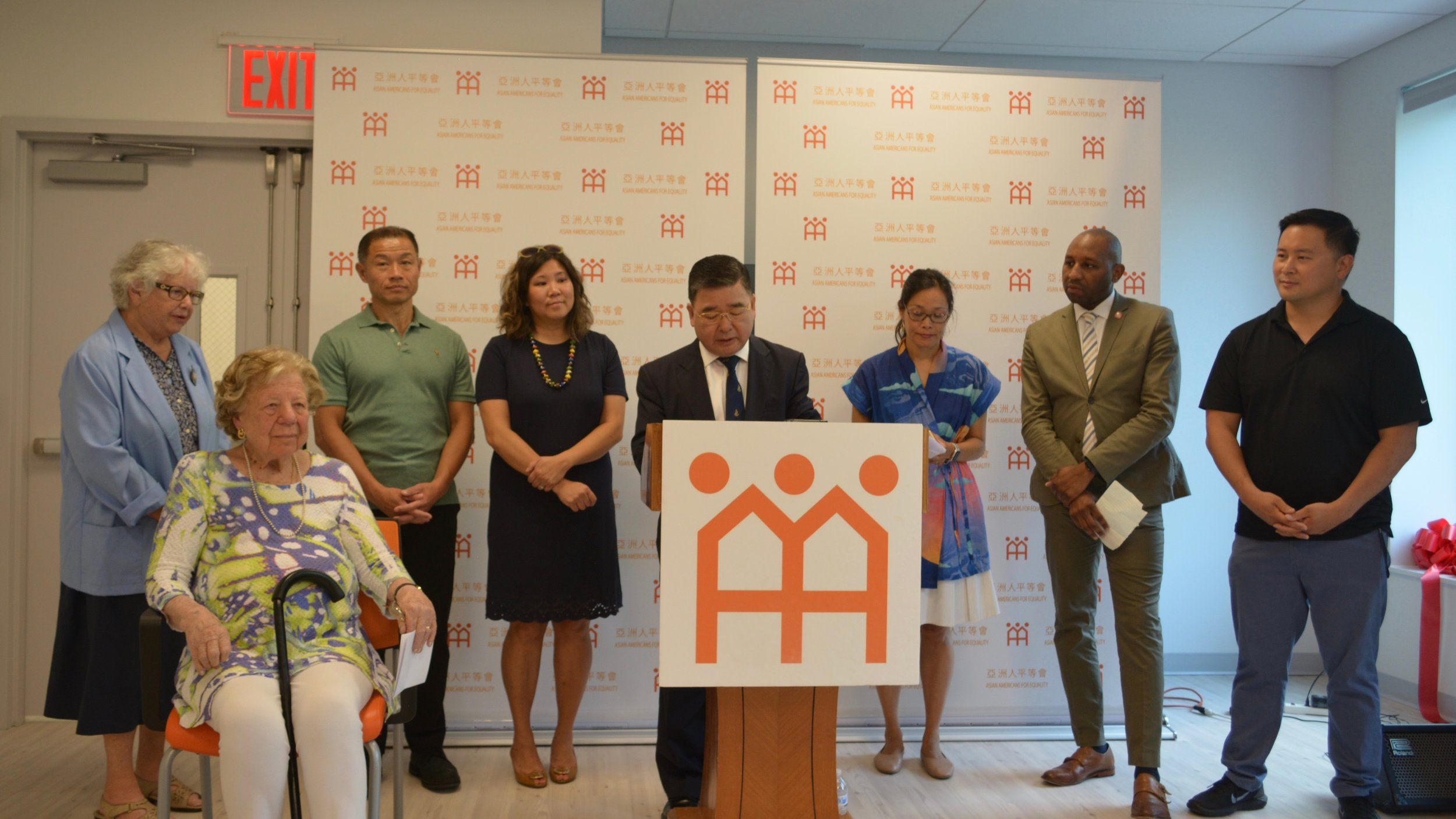 Councilmember Peter Koo speaks at a ribbon cutting for AAFE's new Flushing headquarters. Photo courtesy of AAFE.