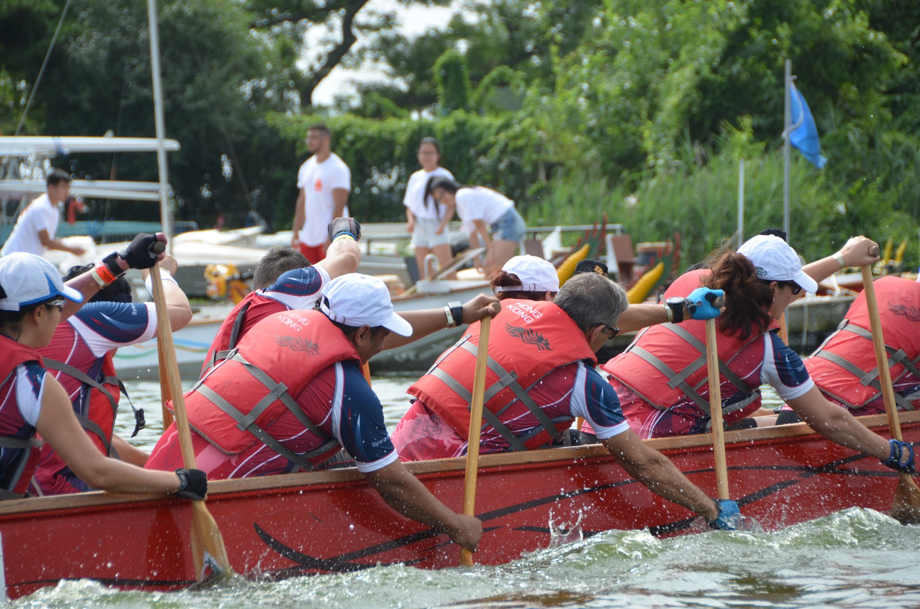 A dragon boat team races during a previous festival. Photo courtesy of Queens EDC.