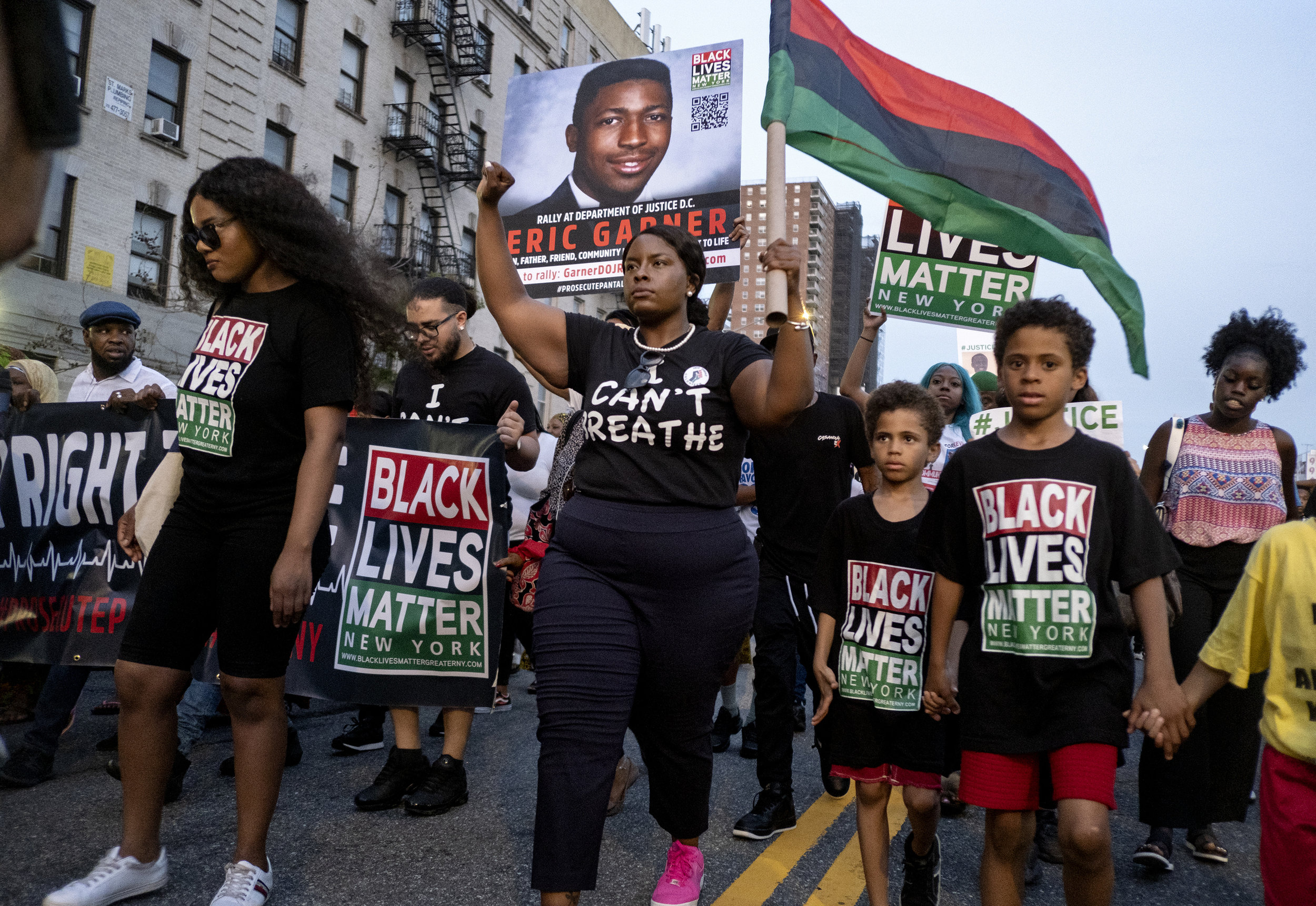 Activists march in Manhattan on the five-year anniversary of Eric Garner's death last month. Garner died as a result of a chokehold administered by NYPD Officer Daniel Pantaleo. AP Photo/Craig Ruttle.