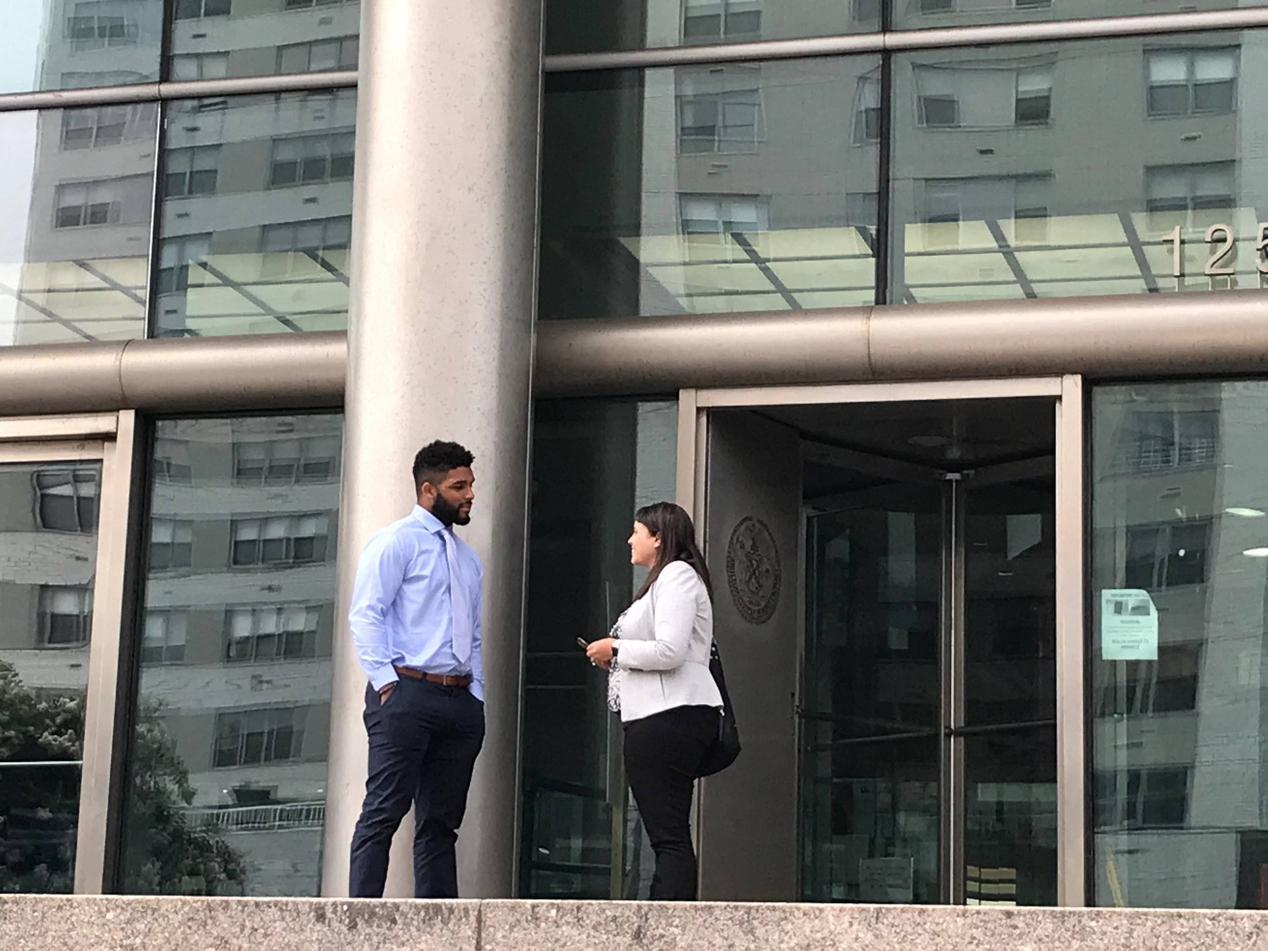 NFL linebacker Trevor Bates exits Queens Supreme Court with his attorney Sarah Stewart of Duane Morris LLP on Tuesday.  Eagle  photo by David Brand.