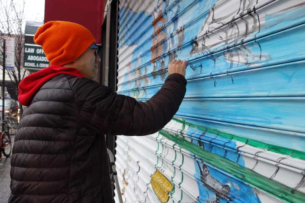 """Queens Council on the Arts grant recipient Chemin Hsiao paints a mural as part of the ArtSite piece, """" My Journey to the West III: Playground ."""" Photo via QCA"""