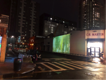 """""""The Ave"""" projected on the side of CH Martin and Rincon Salvadoreno, off Jamaica Ave. Photo by Jason Lalor."""