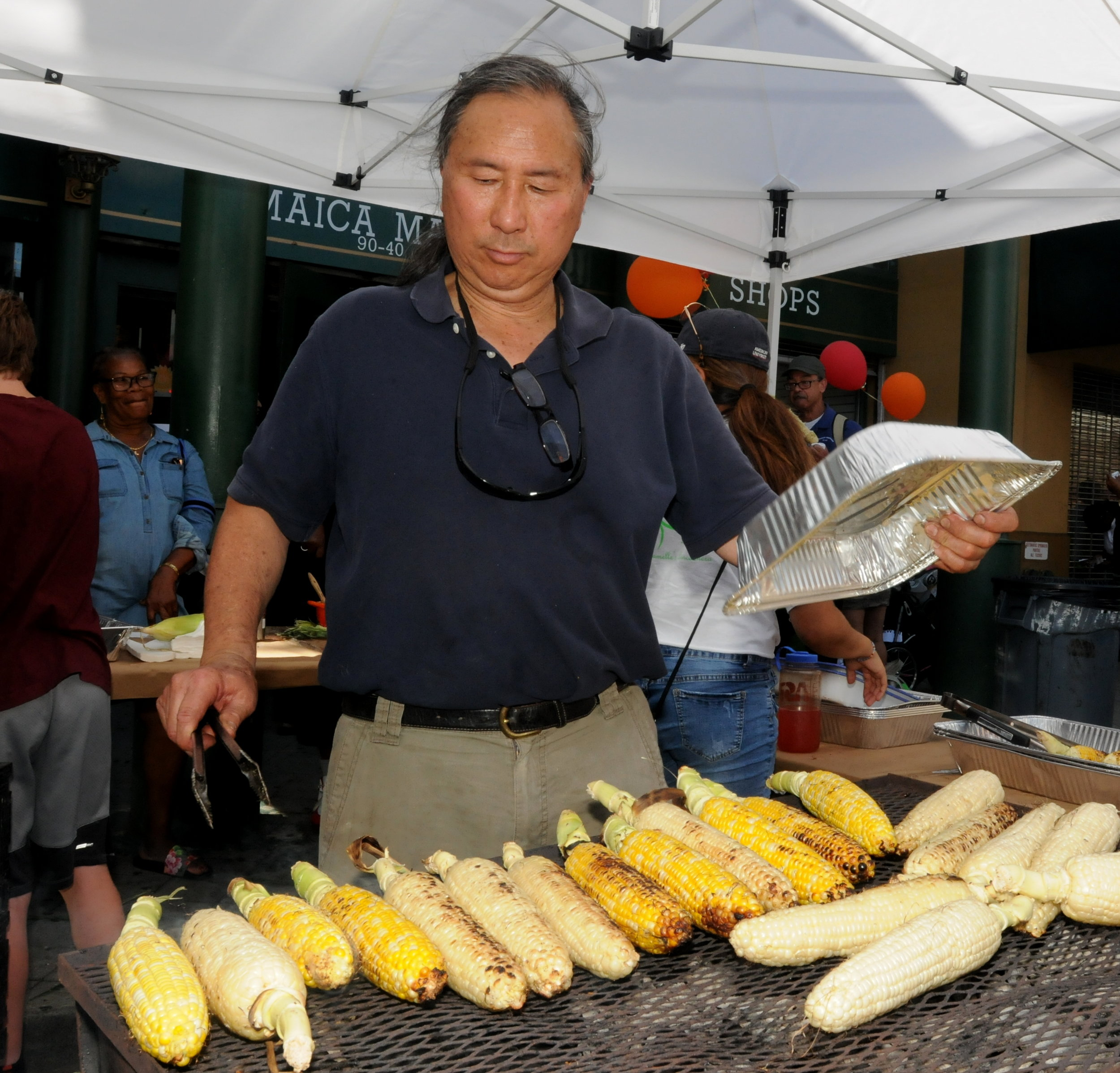 Roastmaster Pono Wong cooks the corn.