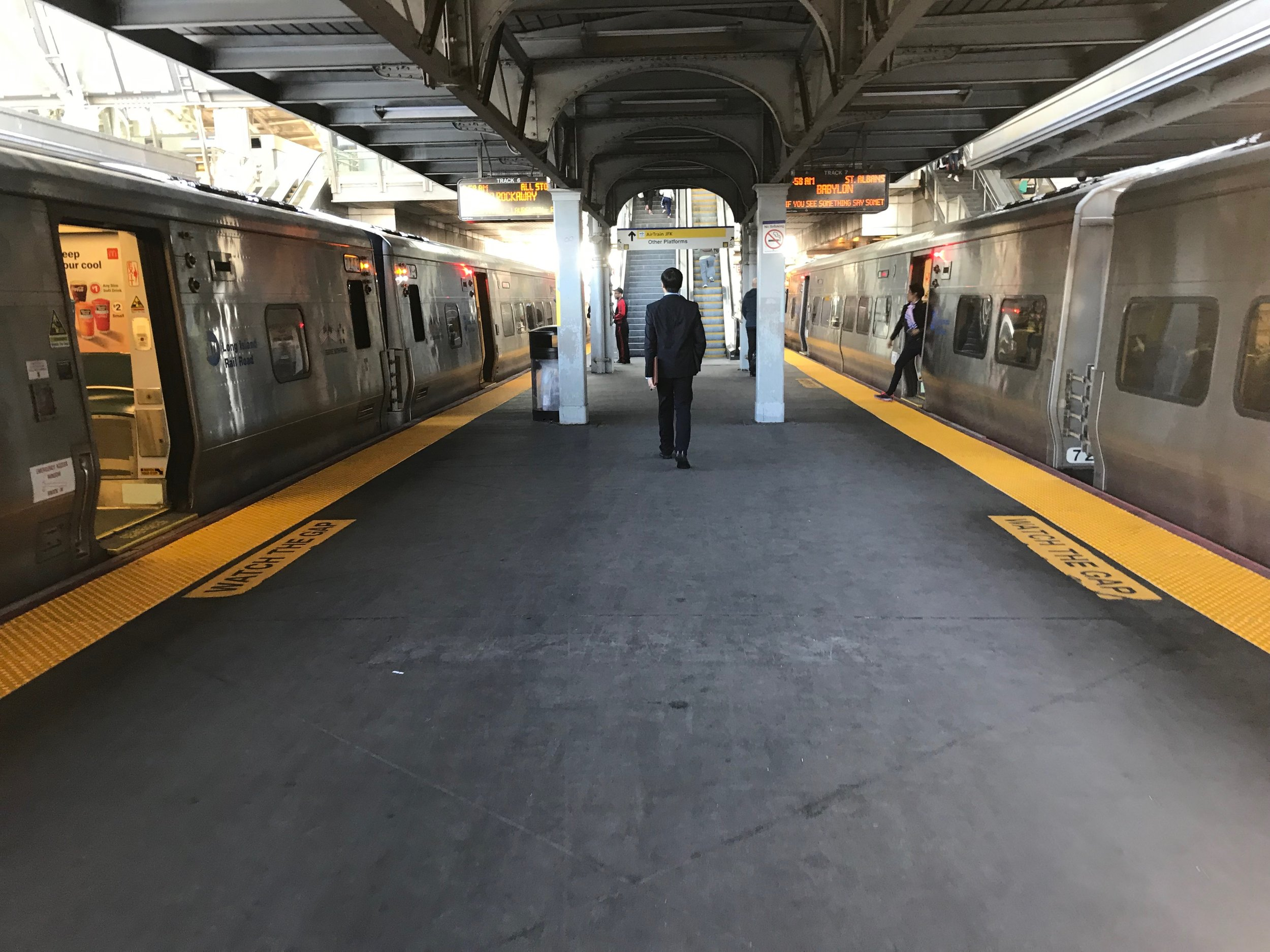 Two LIRR trains stop at the Jamaica station.  Eagle  photo by Jonathan Sperling.