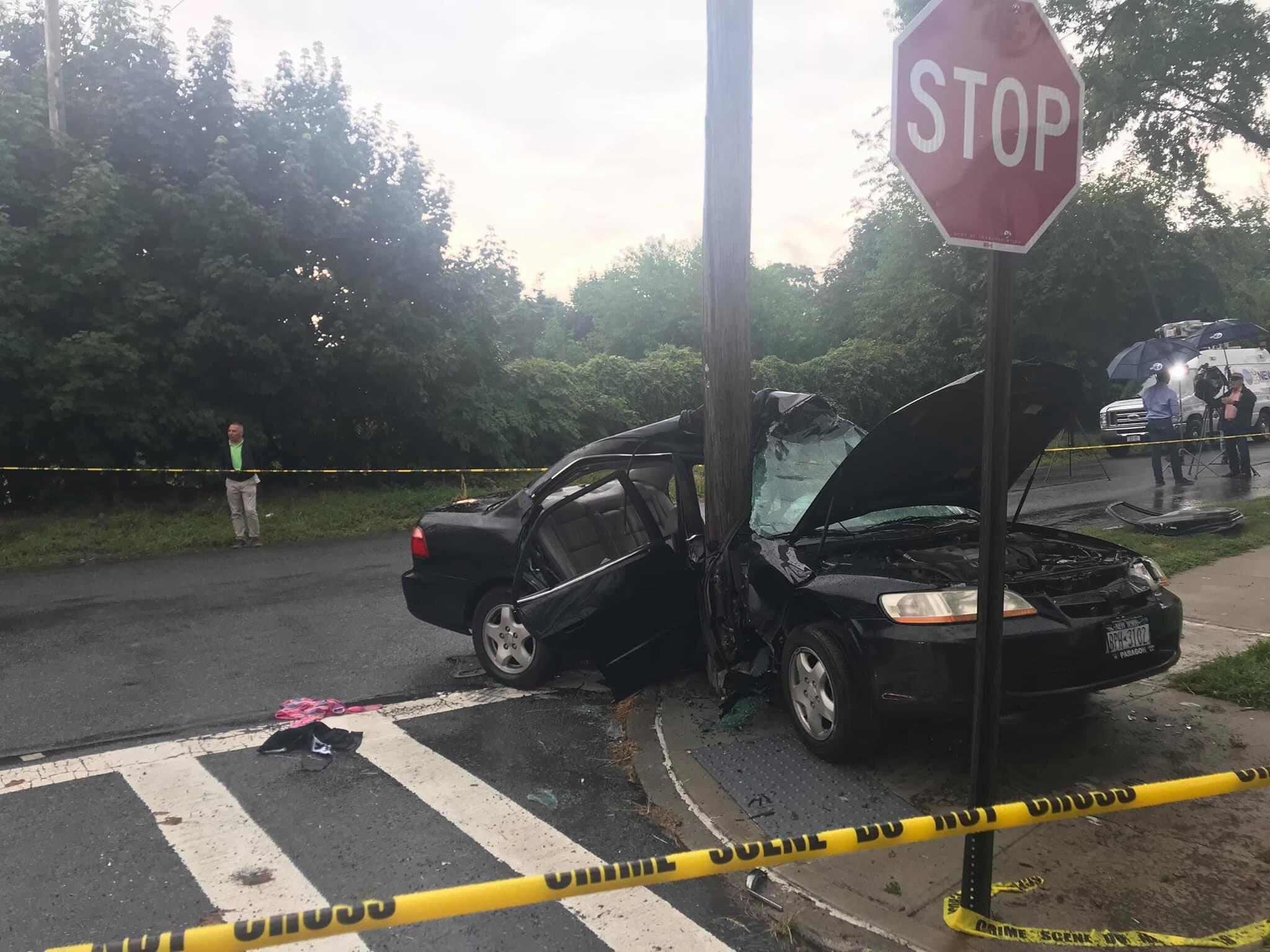 A car in Middle Village with three passengers crashed into a utility pole on Wednesday. Photo via Councilmember Robert Holden.