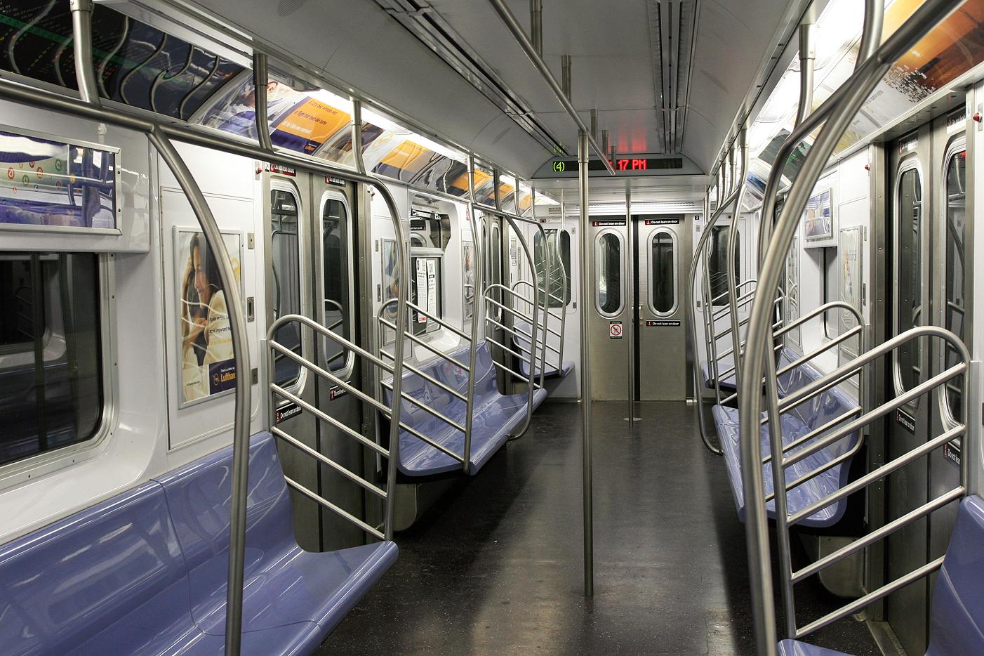 An empty subway car awaits passengers.  Absolutewade  via wikimedia commons.