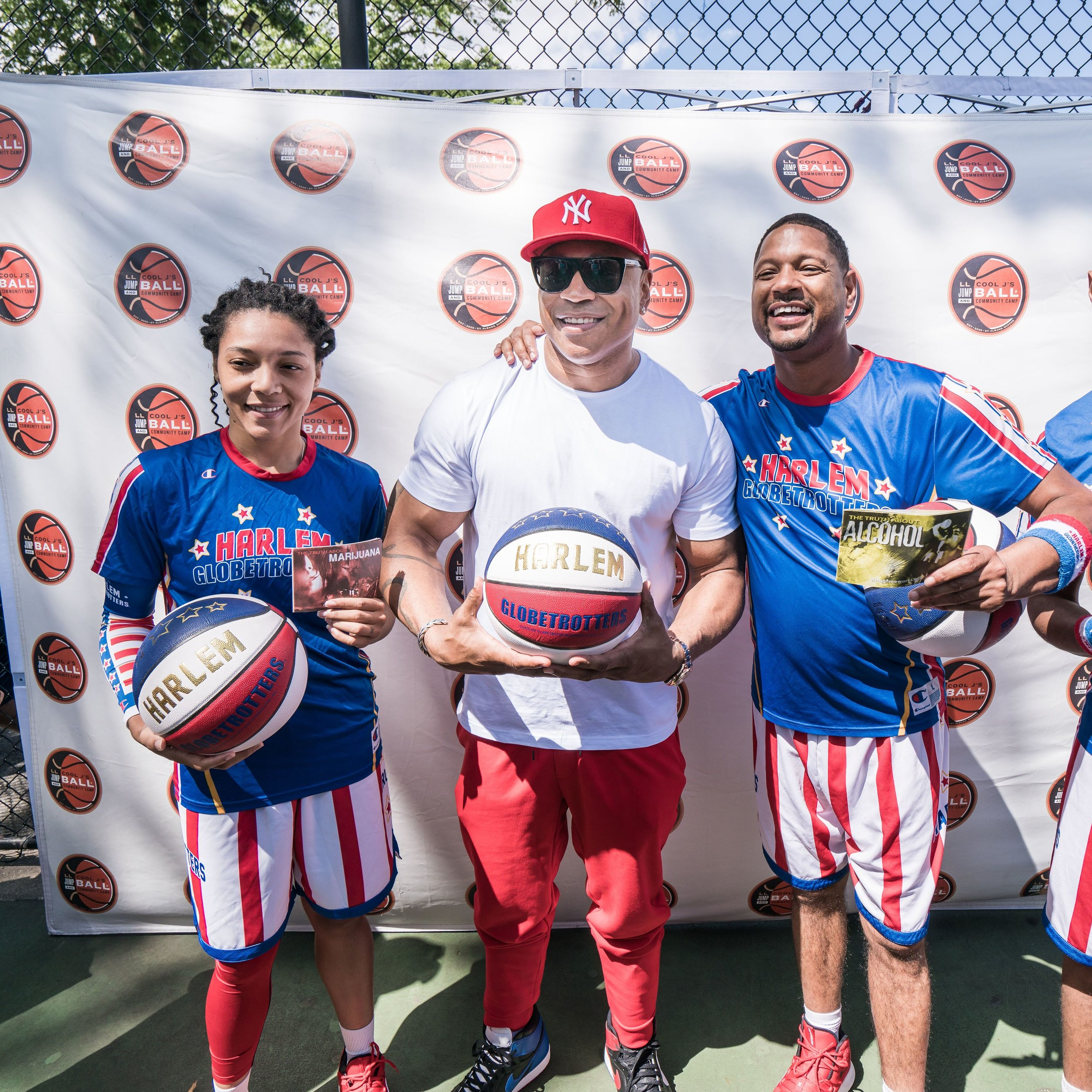 LL Cool J palled around with the Harlem Globetrotters at his charity event last weekend. Photo by Austin Donohue.
