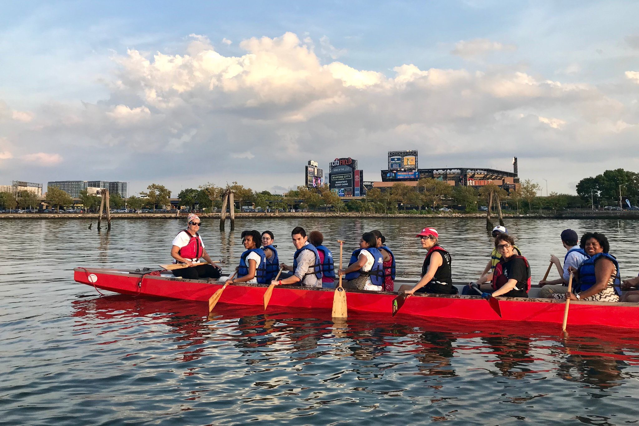 Dragon boat riders sail through Flushing Creek.  Eagle  photos courtesy of Constantinides' office.