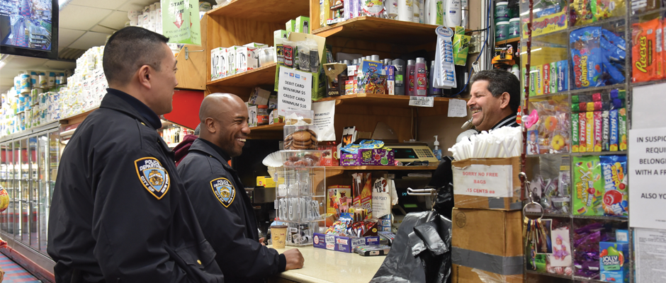 """NYPD Officers visit a community business as part of the """"Build the Block"""" program. Photo via nyc.gov."""