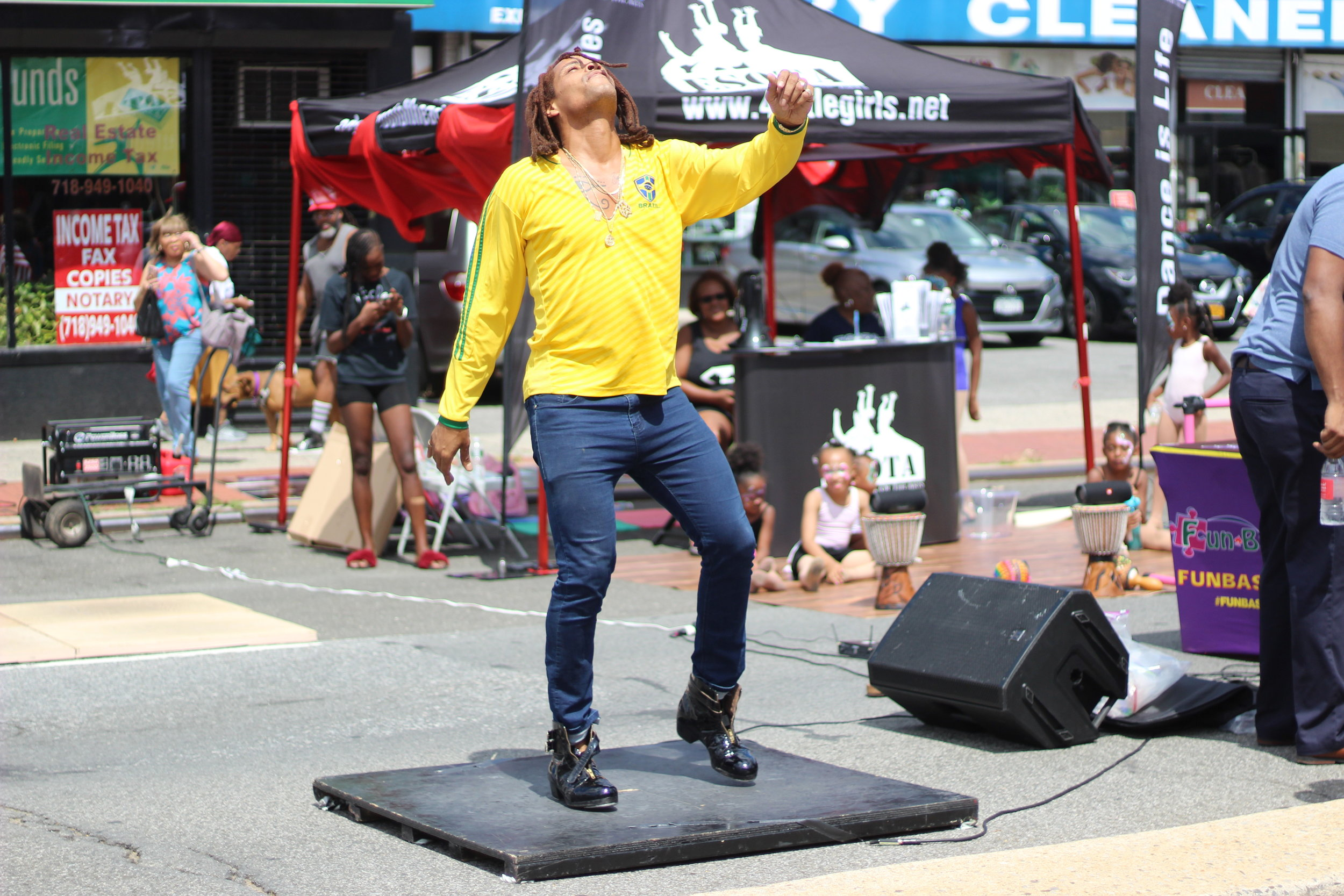 """Omar Edwards taps at a street fair in Laurelton. Edwards will be one of the dancers in choreography Kerri Edge's new piece, """"Reform.""""  Eagle  photos by Victoria Merlino."""