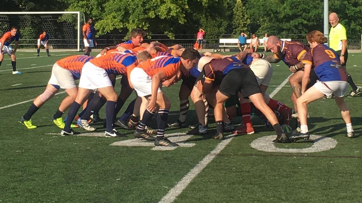 The Queens Rugby Club and the Old Maroon, a Fordham University alumni club, restart play in a scrum.