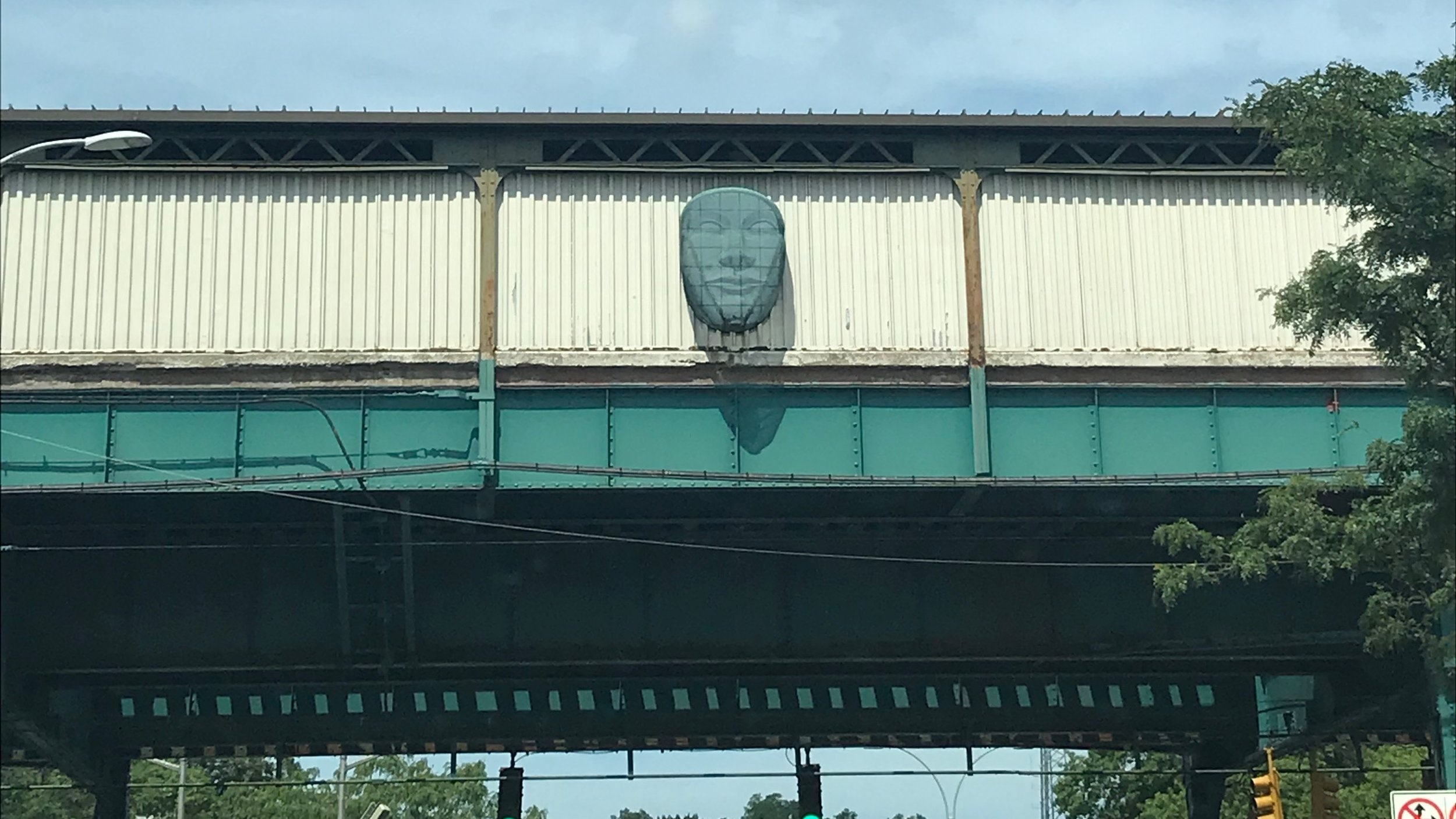 One of five sculpted faces watch over the Woodhaven Boulevard subway station in Woodhaven.  Eagle  photo by Jonathan Sperling.