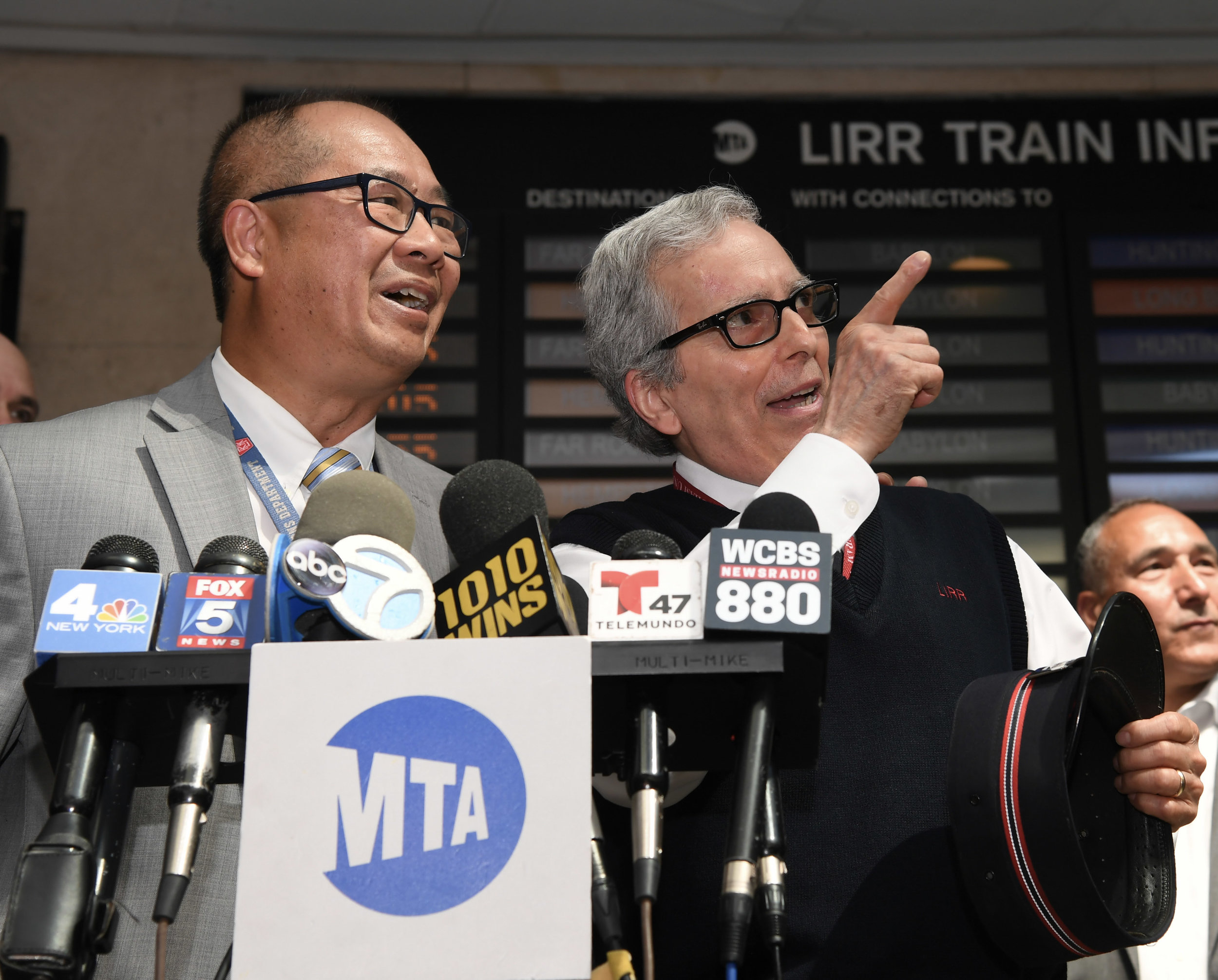 Conductor Jerry Savino (right) was honored by LIRR President Phil Eng at Atlantic Terminal in Brooklyn on Tuesday after Savino turned in $9,000 cash he had found aboard his train. Photos by Marc A. Hermann / MTA New York City Transit.